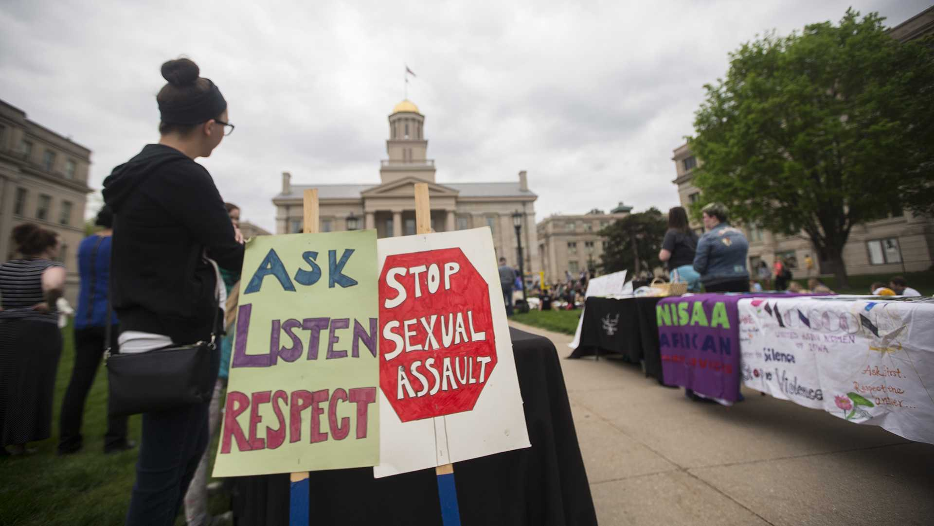 Community members participate in a march for Take Back the Night on Tuesday, April 25, 2017. Take Back the Night was a sexual assault awareness event. (The Daily Iowan/Joseph Cress)