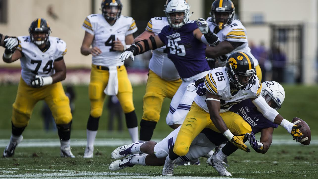 Iowa running back Akrum Wadley misses a pass from quarterback Nate Stanley during the game between Iowa and Northwestern at Ryan Field in Evanston Oct. 21, 2017. (Ben Smith/The Daily Iowan)