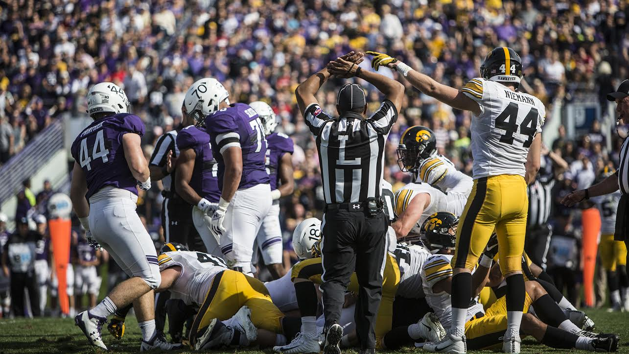 Iowa's Ben Niemann signals for an Iowa turnover during the game between Iowa and Northwestern at Ryan Field in Evanston on Oct. 21. The Wildcats defeated the Hawkeyes 17-10. (Ben Smith/The Daily Iowan)