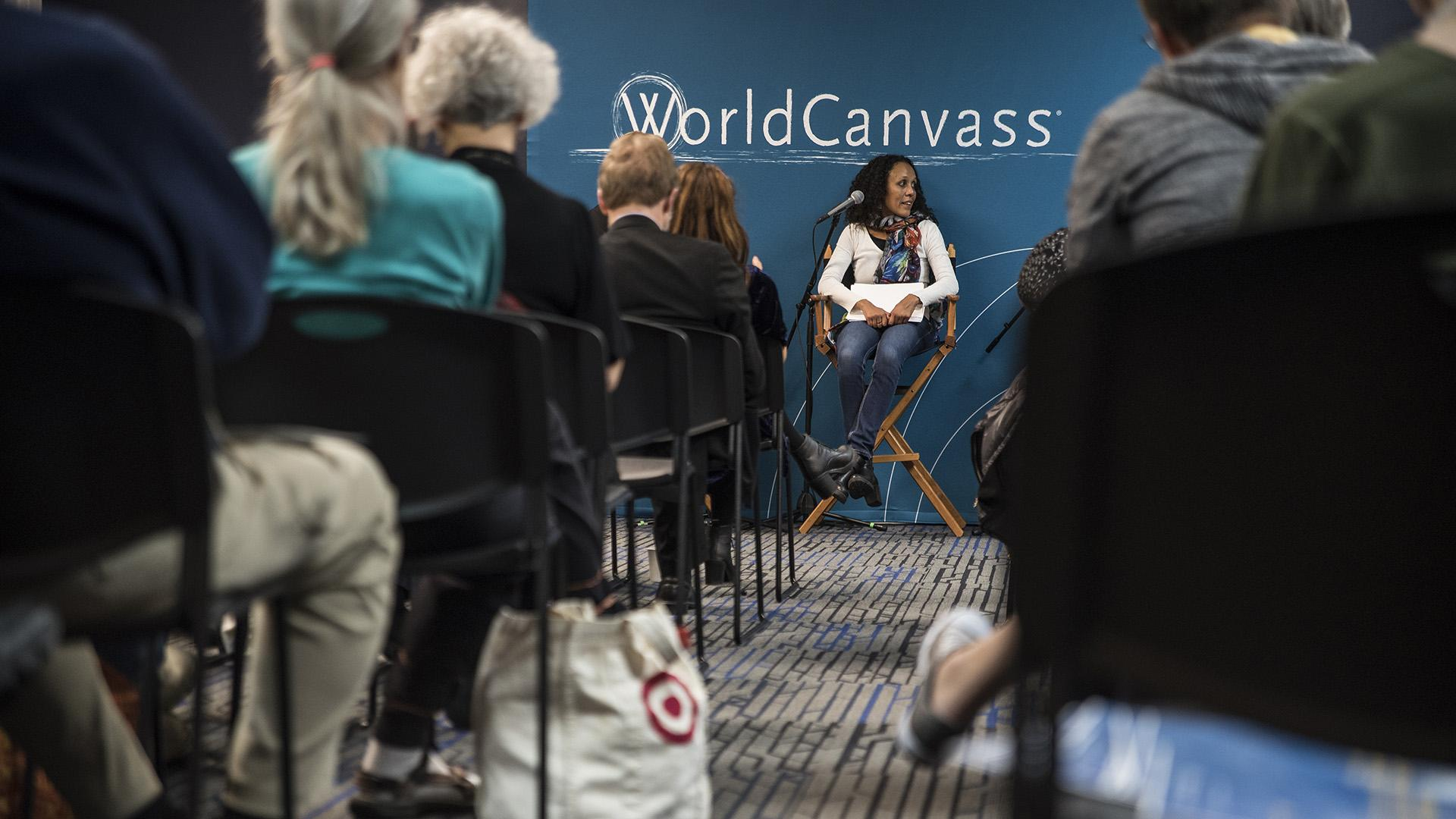 Attendees listen to a panel discussion during the World Canvass lecture at Merge on Wednesday, Oct. 18, 2017. The topic of discussion was fake news in the modern media. (Ben Smith/The Daily Iowan)