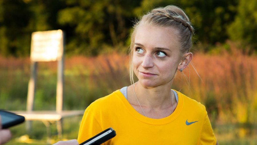 Andrea+Shine+speaks+to+the+media+at+the+Hawkeye+Invitational+Cross+Country+meet+on+Friday%2C+September+1%2C+2017.+