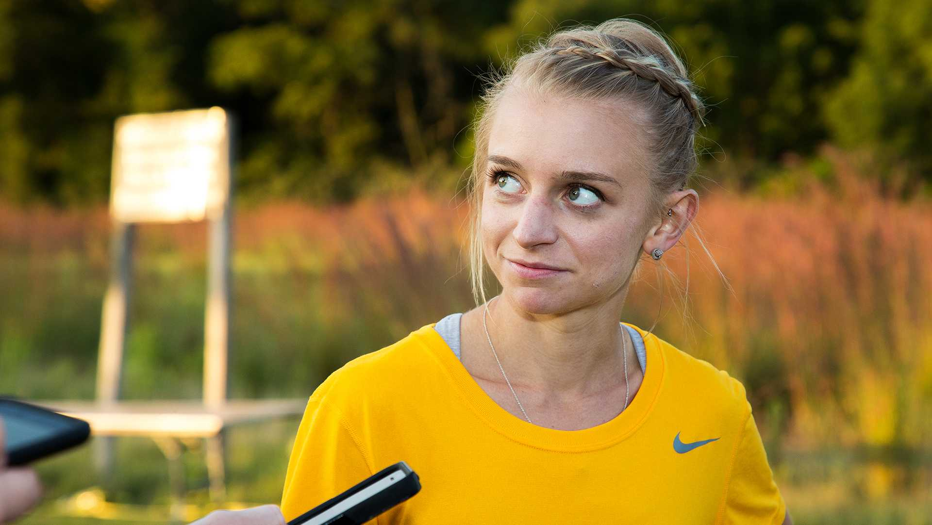 Andrea Shine speaks to the media at the Hawkeye Invitational Cross Country meet on Friday, September 1, 2017.