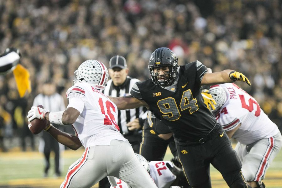 Iowa+defensive+end+A.J.+Epenesa+goes+for+a+sack+against+Ohio+State+quarterback+J.T.+Barrett+during+the+Iowa%2FOhio+State+football+game+in+Kinnick+Stadium+on+Saturday%2C+Nov.+4%2C+2017.+The+Hawkeyes+defeated+the+Buckeyes+in+a+storming+fashion%2C+55-24.+%28Joseph+Cress%2FThe+Daily+Iowan%29