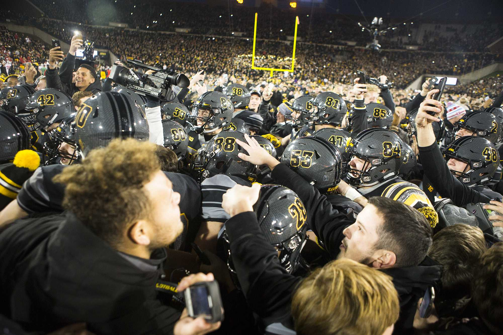 Iowa fans storm the field during the Iowa/Ohio State football game in Kinnick Stadium on Saturday, Nov. 4, 2017. The Hawkeyes defeated the Buckeyes in a storming fashion, 55-24. (Joseph Cress/The Daily Iowan)