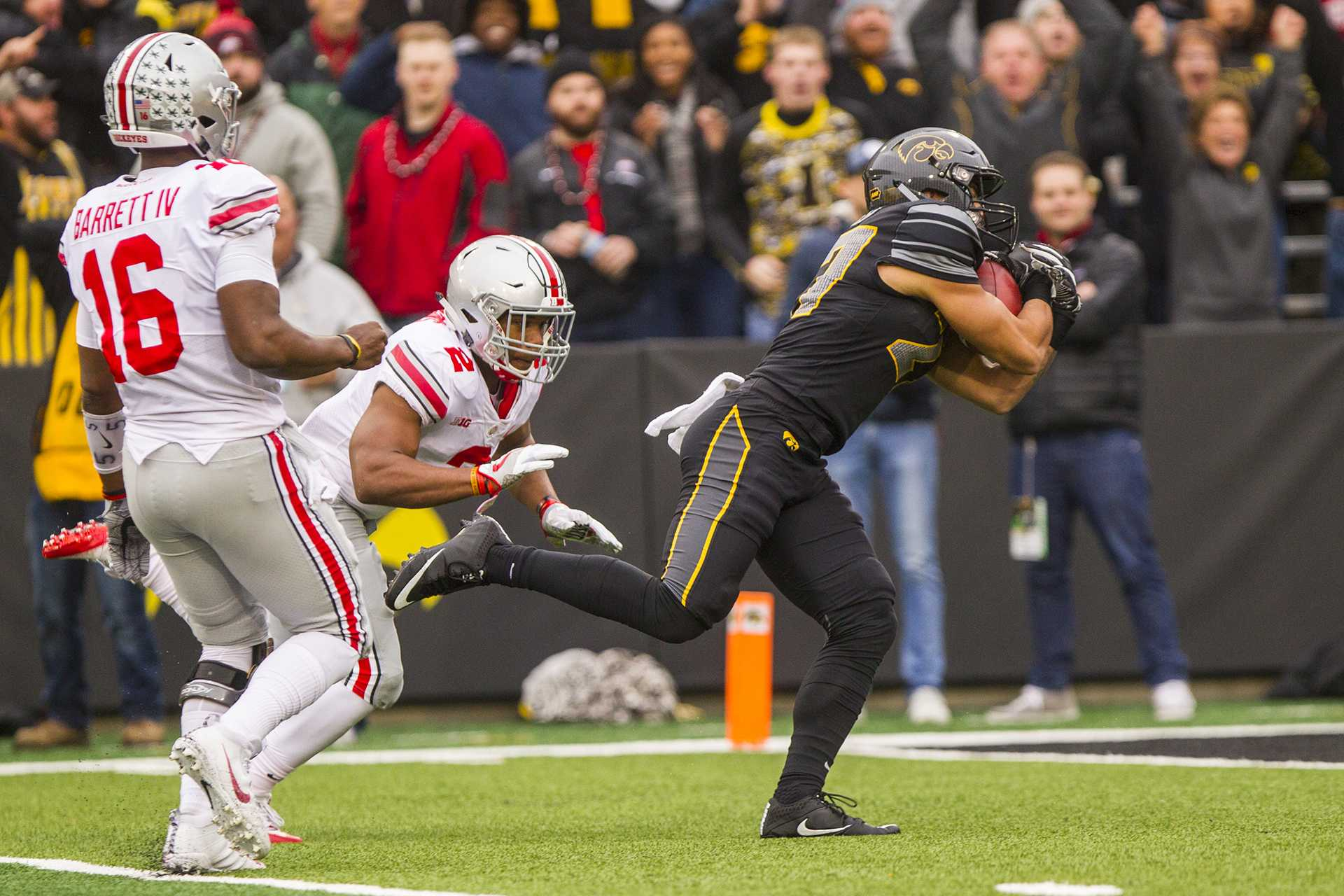 Iowa strong safety Amani Hooker dives into the end zone after intercepting a pass on Ohio State's first play from scrimmage during Iowa's game against Ohio State at Kinnick Stadium on Saturday, Nov. 4, 2017. The Hawkeyes defeated the Buckeyes 55 to 24. (Nick Rohlman/The Daily Iowan)