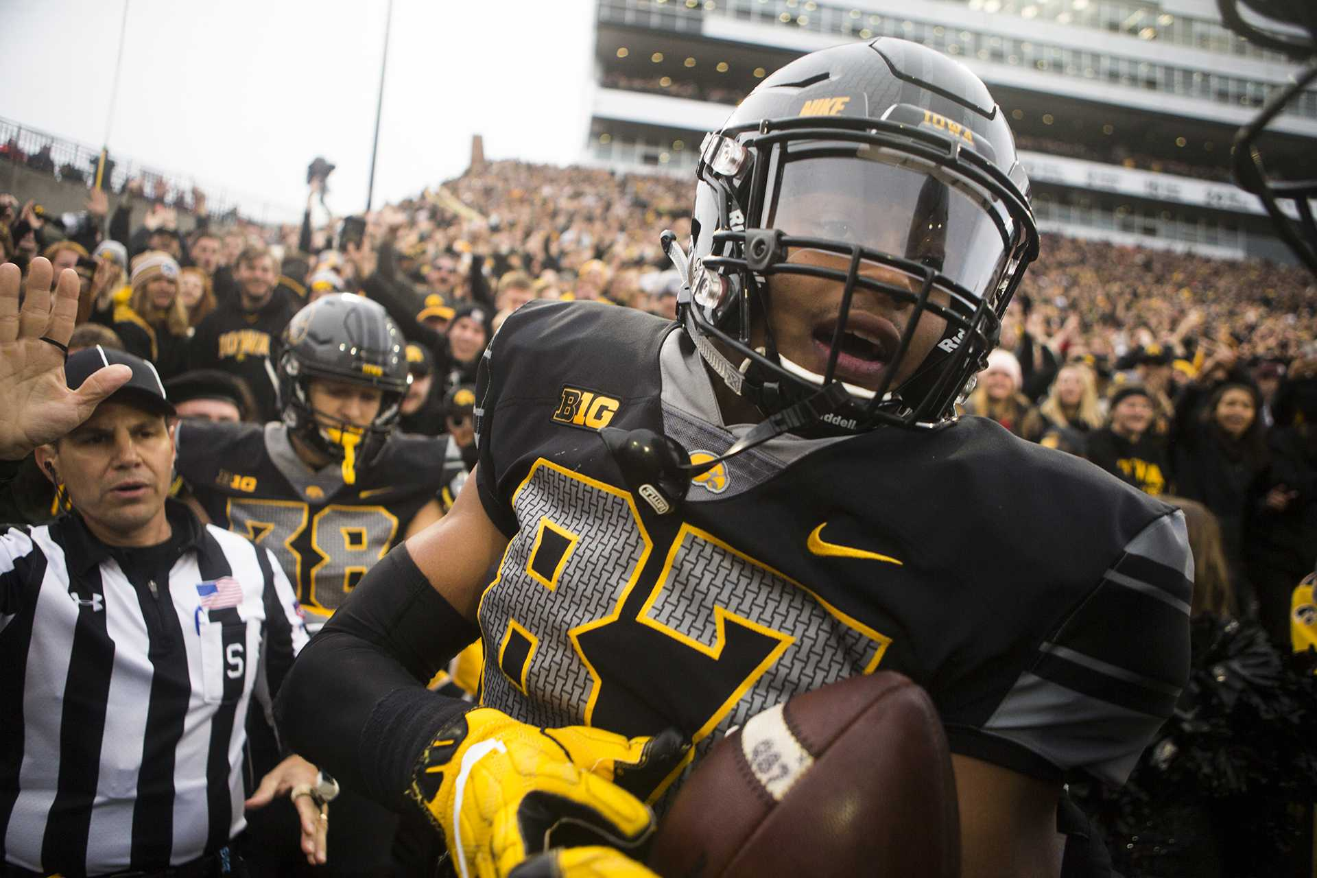 Iowa tight end Noah Fant celebrates with teammates after scoring a touchdown during the Iowa/Ohio State football game in Kinnick Stadium on Saturday, Nov. 4, 2017. The Hawkeyes defeated the Buckeyes in a storming fashion, 55-24. (Joseph Cress/The Daily Iowan)