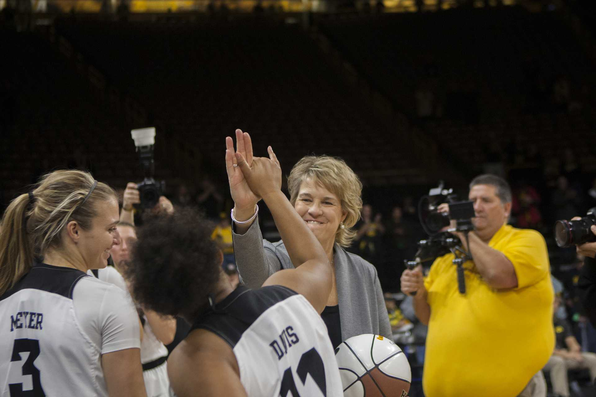 Iowa head coach Lisa Bluder high fives guard Tania Davis during the Iowa/Quinnipiac basketball game at Carver-Hawkeye Arena on Friday, Nov. 10, 2017. The Hawkeyes defeated the Bobcats, 83-67, for head coach Lisa Bluder's 700 career win. (Lily Smith/The Daily Iowan)