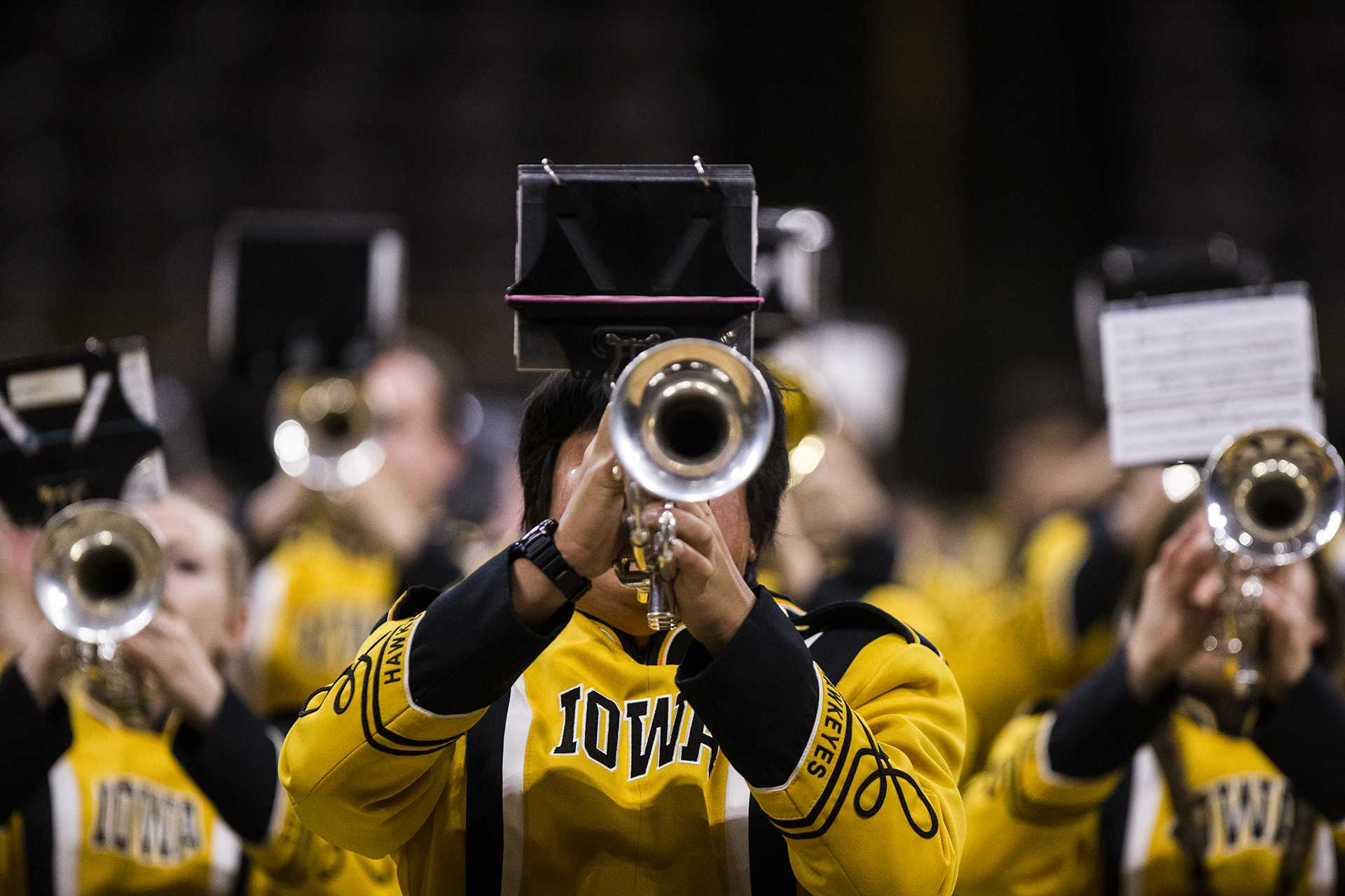 Members of the Hawkeye Marching Band perform during the Band Extravaganza at Carver-Hawkeye Arena on Monday, Nov. 13, 2017. The 260 member group performed favorites from an array of songs. (Ben Smith/The Daily Iowan)