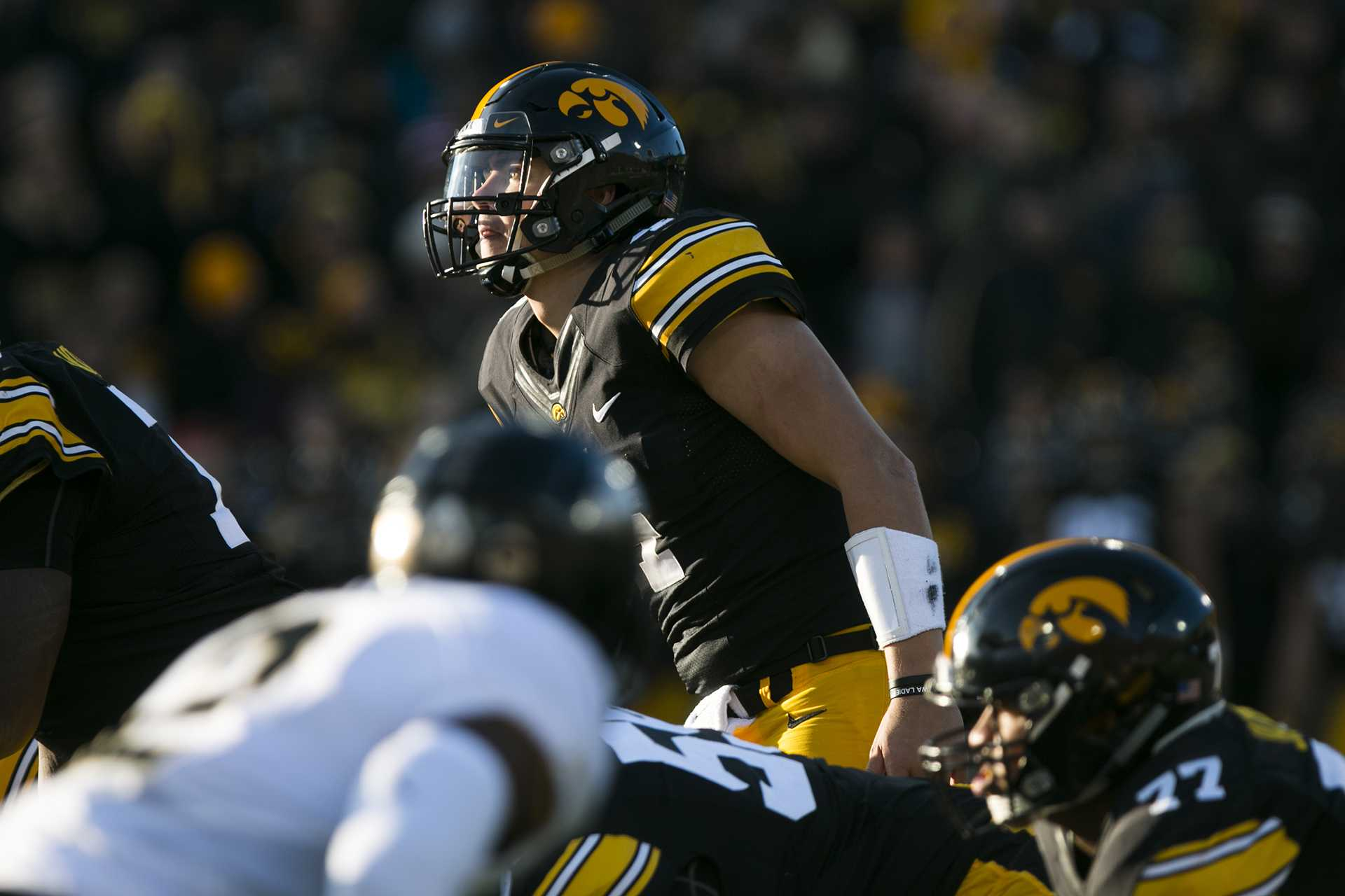 Iowa quarterback Nate Stanley looks up into the sun during the Iowa/Purdue football game in Kinnick Stadium on Saturday, Nov. 18, 2017. The Boilermakers defeated the Hawkeyes, 24-15. (Joseph Cress/The Daily Iowan)