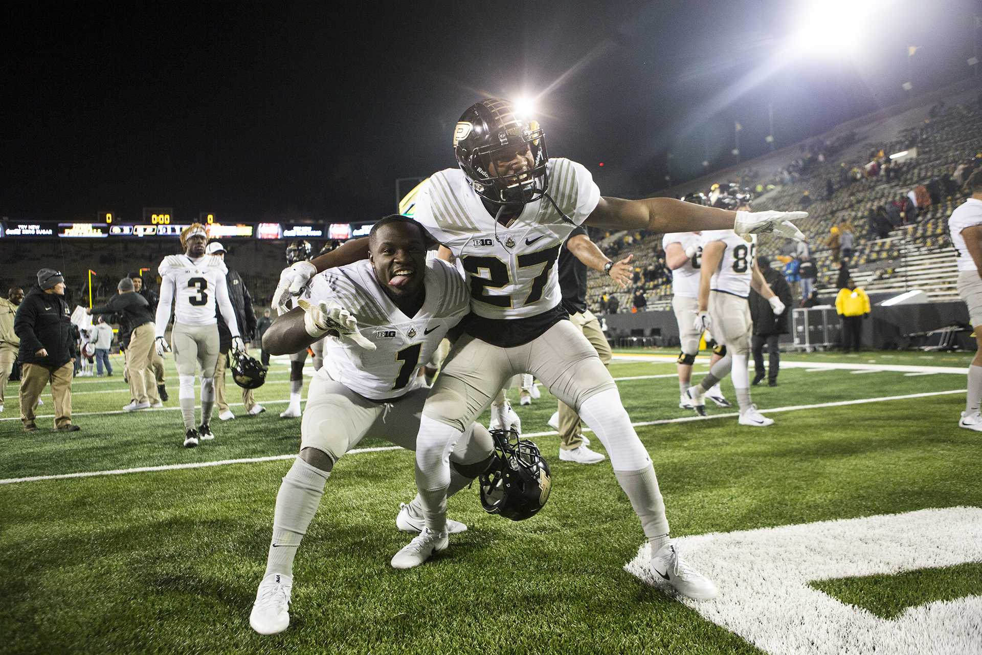 Purdue running back D.J. Knox (1) and safety Navon Mosley (27) play to cameras during the Iowa/Purdue football game in Kinnick Stadium on Saturday, Nov. 18, 2017. The Boilermakers defeated the Hawkeyes, 24-15. (Joseph Cress/The Daily Iowan)