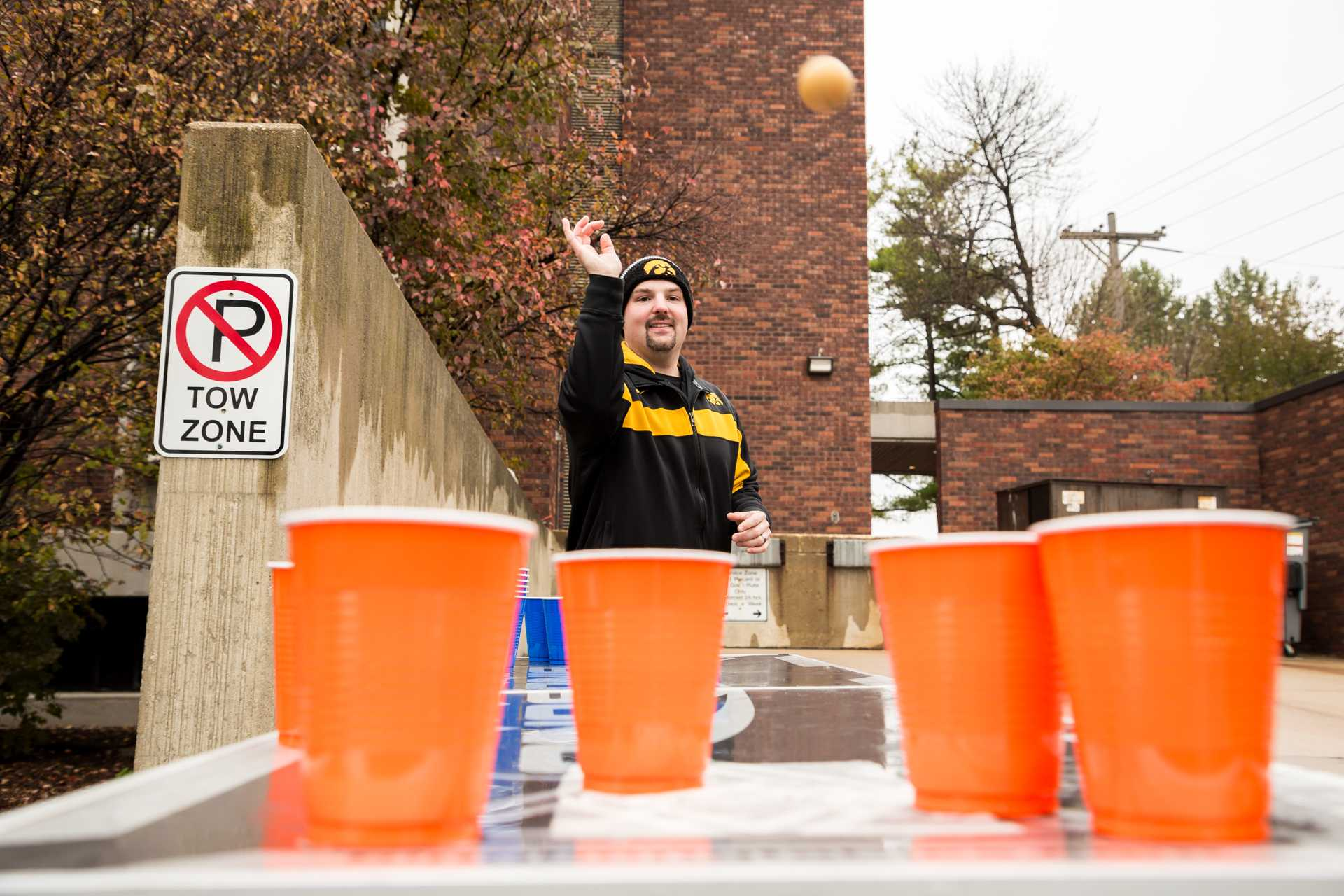 Devin Conover plays beer pong while tailgating before the football game between the University of Iowa and Ohio State University on Saturday, Nov. 4, 2017. (David Harmantas/The Daily Iowan)