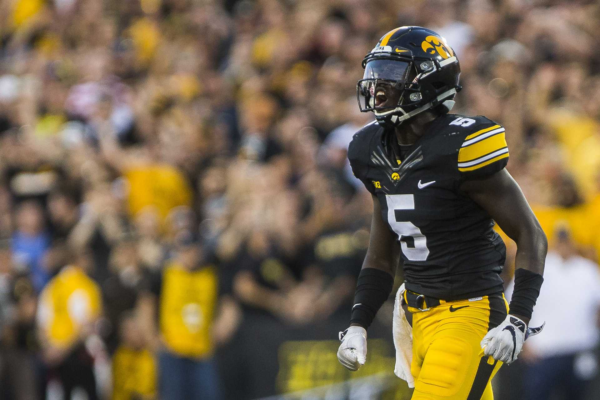 Manny Rugamba runs toward the sideline during the game between Iowa and Penn State at Kinnick Stadium on Saturday, Sept. 23, 2017. Both teams are going into the game undefeated with records of 3-0. (Ben Smith/The Daily Iowan)