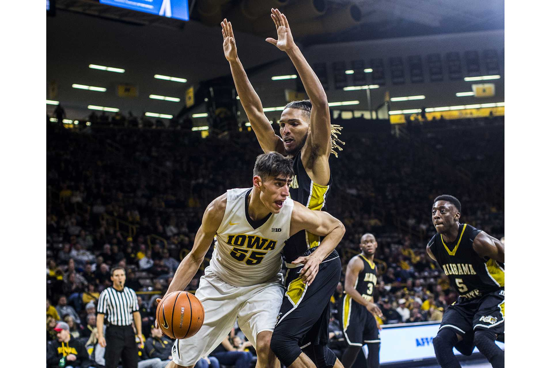 Iowa forward Luka Garza dribbles on the baseline under a Alabama State defender during a men's basketball game in Carver-Hawkeye Arena on Sunday, Nov. 12, 2017. The Hawkeyes defeated the Hornets, 92-58. (Nick Rohlman/The Daily Iowan)