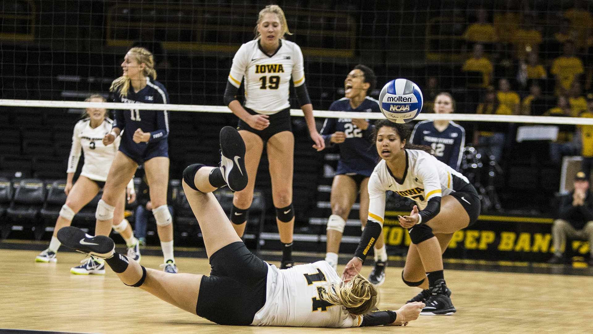 Iowa's Cali Hoye (14) dives for a missed shot during the match between Iowa and Penn State at Carver-Hawkeye Arena on Wednesday, Nov. 8, 2017. The Hawkeyes lost to the Nittany Lions 3-0. (Ben Smith/The Daily Iowan)