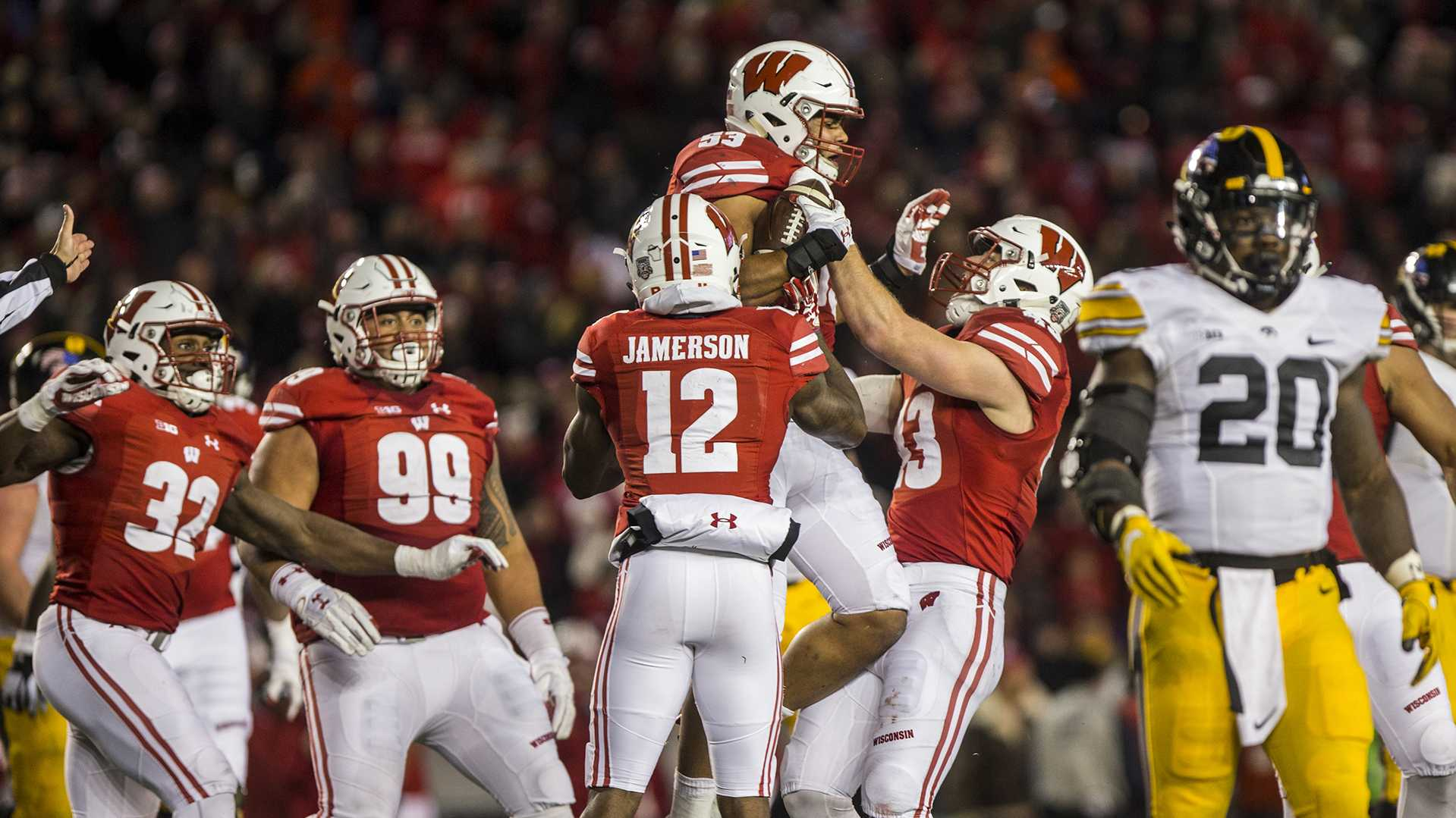 Iowa running back James Butler walks off the field as Wisconsin players celebrate a turnover during Iowa's game against Wisconsin at Camp Randall Stadium in Madison, Wisconsin on Saturday, Nov. 11, 2017. The Badgers defeated the Hawkeyes 38-14. (Nick Rohlman/The Daily Iowan)
