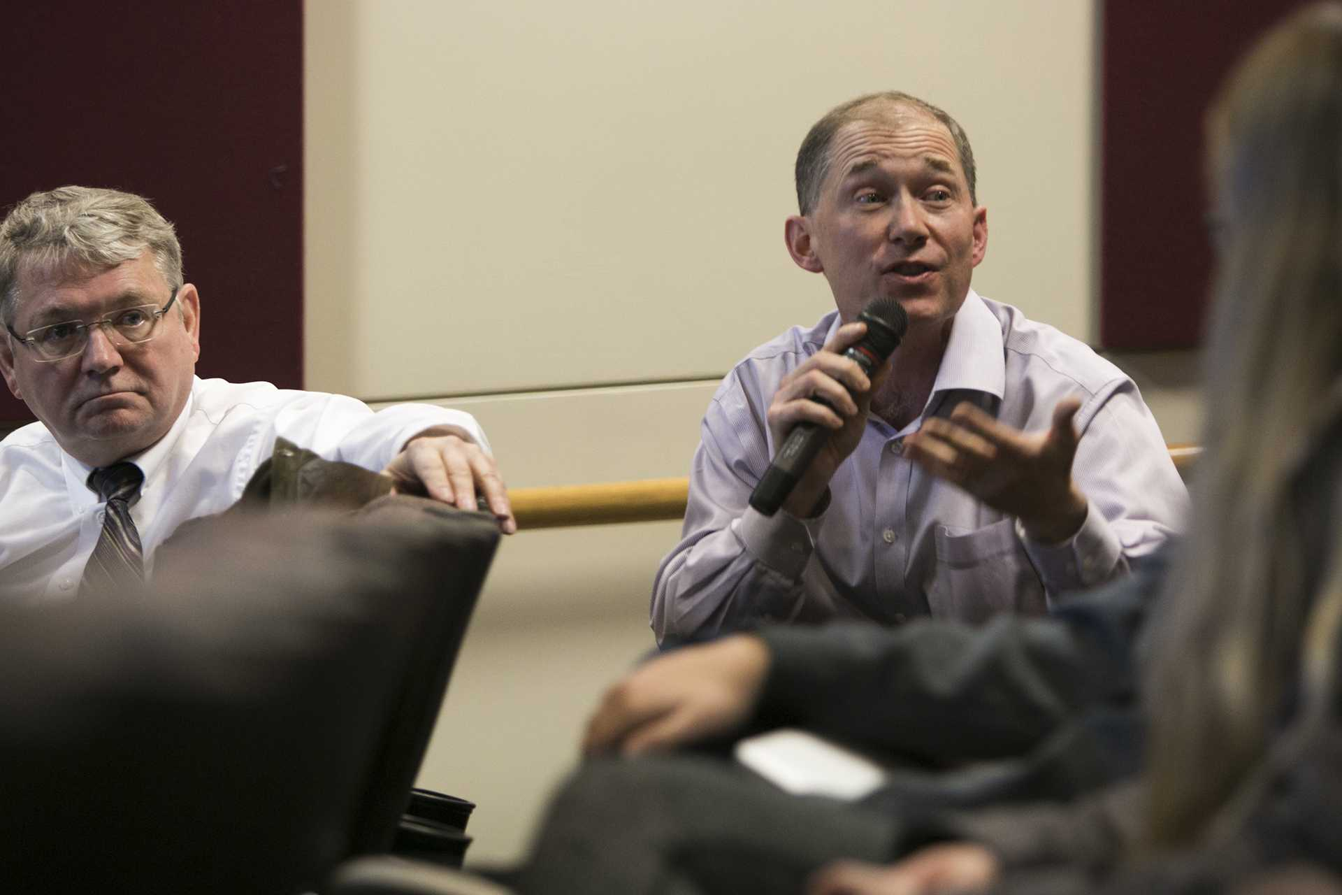 UI Associate Professor of Chemistry Chris Cheatum gestures during a UI 2020 Initiative forum meeting with the Steering Committee in the Iowa Theatre inside the IMU on Monday, Nov. 13, 2017. The committee listened to comment from faculty, staff, students, and community members. (Joseph Cress/The Daily Iowan)