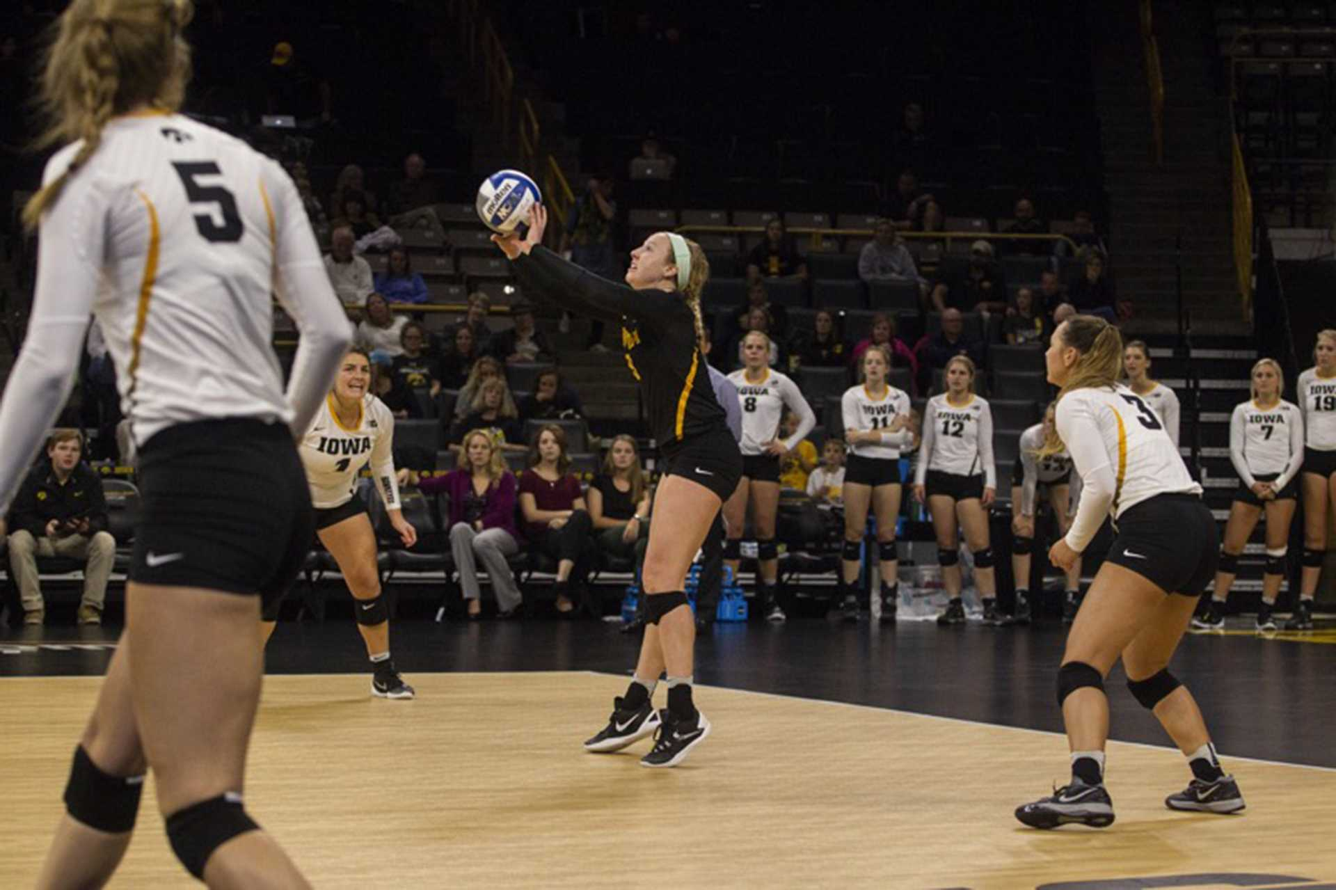 FILE - Iowa's No. 9 Annika Olsen receives the ball during a volleyball match at the Carver Hawkeye Arena in Iowa City on Friday, Oct 7, 2016. Iowa defeated Purdue 3-2. (The Daily Iowan/file)