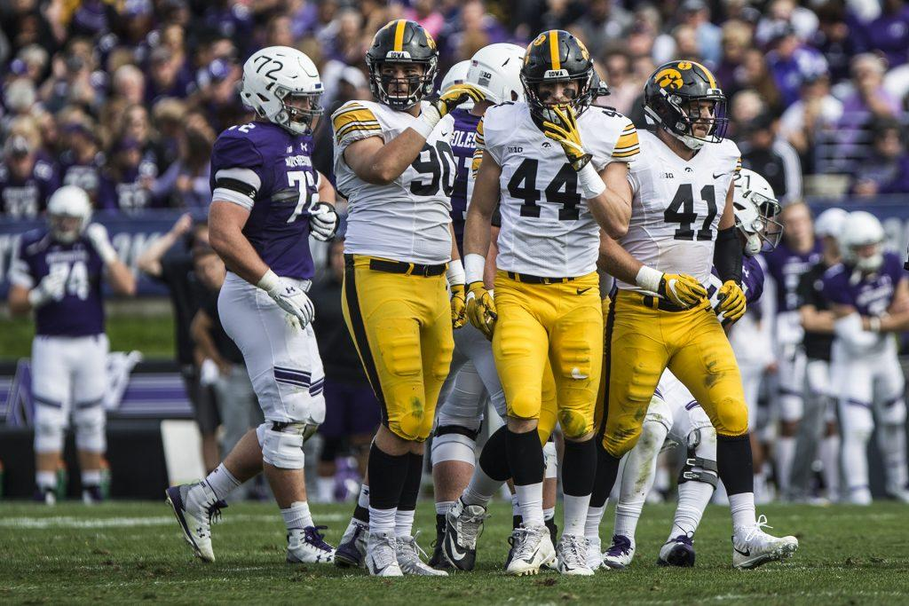 Iowa%27s+Sam+Brincks+%2890%29%2C+Ben+Niemann+%2844%29%2C+and+Bo+Bower+%2841%29+walk+off+the+field+during+the+game+between+Iowa+and+Northwestern+at+Ryan+Field+in+Evanston%2C+Ill.+on+Saturday%2C+Oct.+21%2C+2017.+The+Wildcats+defeated+the+Hawkeyes+17-10+in+overtime.+%28Ben+Smith%2FThe+Daily+Iowan%29