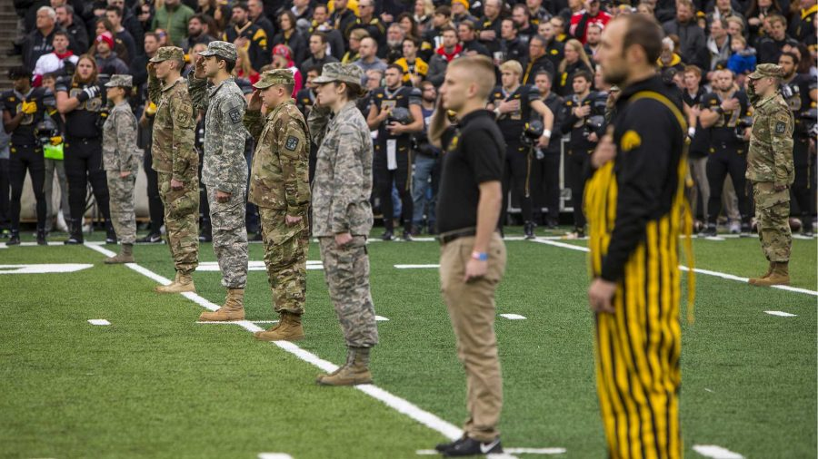 Veterans+stand+on+the+field+during+the+national+anthem+before+Iowa%27s+game+against+Ohio+State+at+Kinnick+Stadium+on+Saturday%2C+Nov.+4%2C+2017.+The+Hawkeyes+defeated+the+Buckeyes+55+to+24.+%28Nick+Rohlman%2FThe+Daily+Iowan%29
