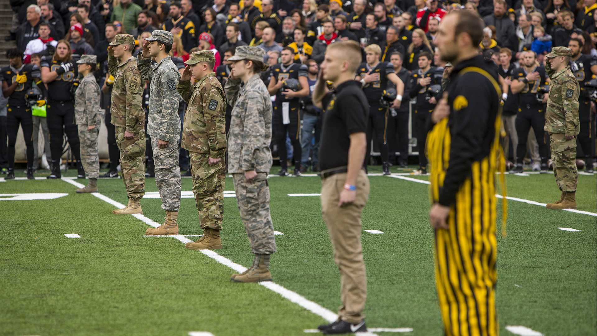 Veterans stand on the field during the national anthem before Iowa's game against Ohio State at Kinnick Stadium on Saturday, Nov. 4, 2017. The Hawkeyes defeated the Buckeyes 55 to 24. (Nick Rohlman/The Daily Iowan)