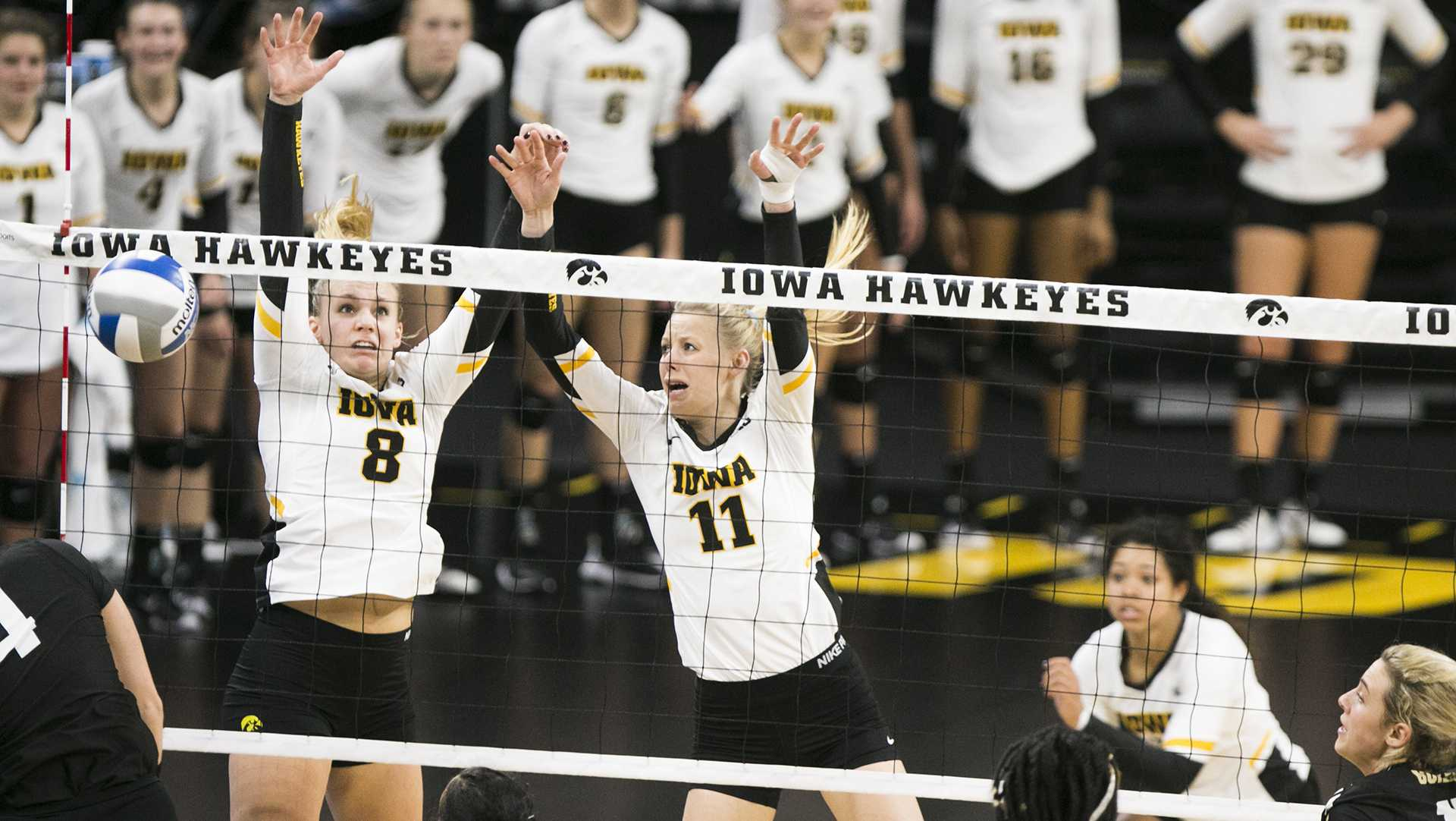 Iowa's Reghan Coyle and middle blocker Kelsey O'Neill block a spike during an Iowa/Purdue volleyball game in Carver-Hawkeye Arena on Sunday, Nov. 5, 2017. The Boilermakers defeated the Hawkeyes, 3-2. (Joseph Cress/The Daily Iowan)