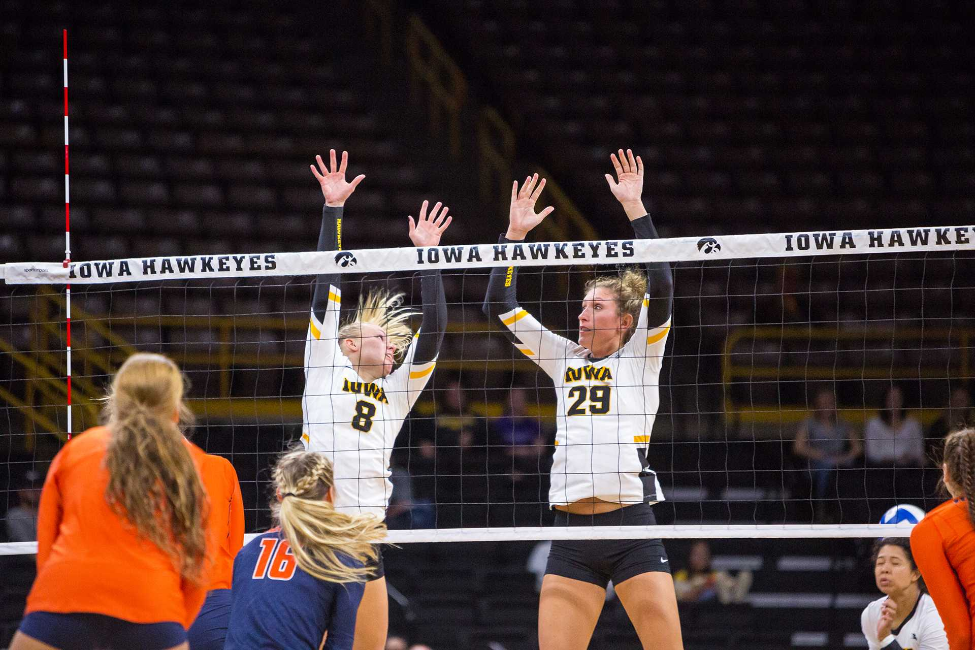 Iowa Hawkeye Volleyball players Jess Janota and Reghan Coyle try to defend the net during a match against the University of Illinois Fighting Illini on Friday, Oct. 19, 2017. The Illini defeated the Hawkeyes three sets to two.