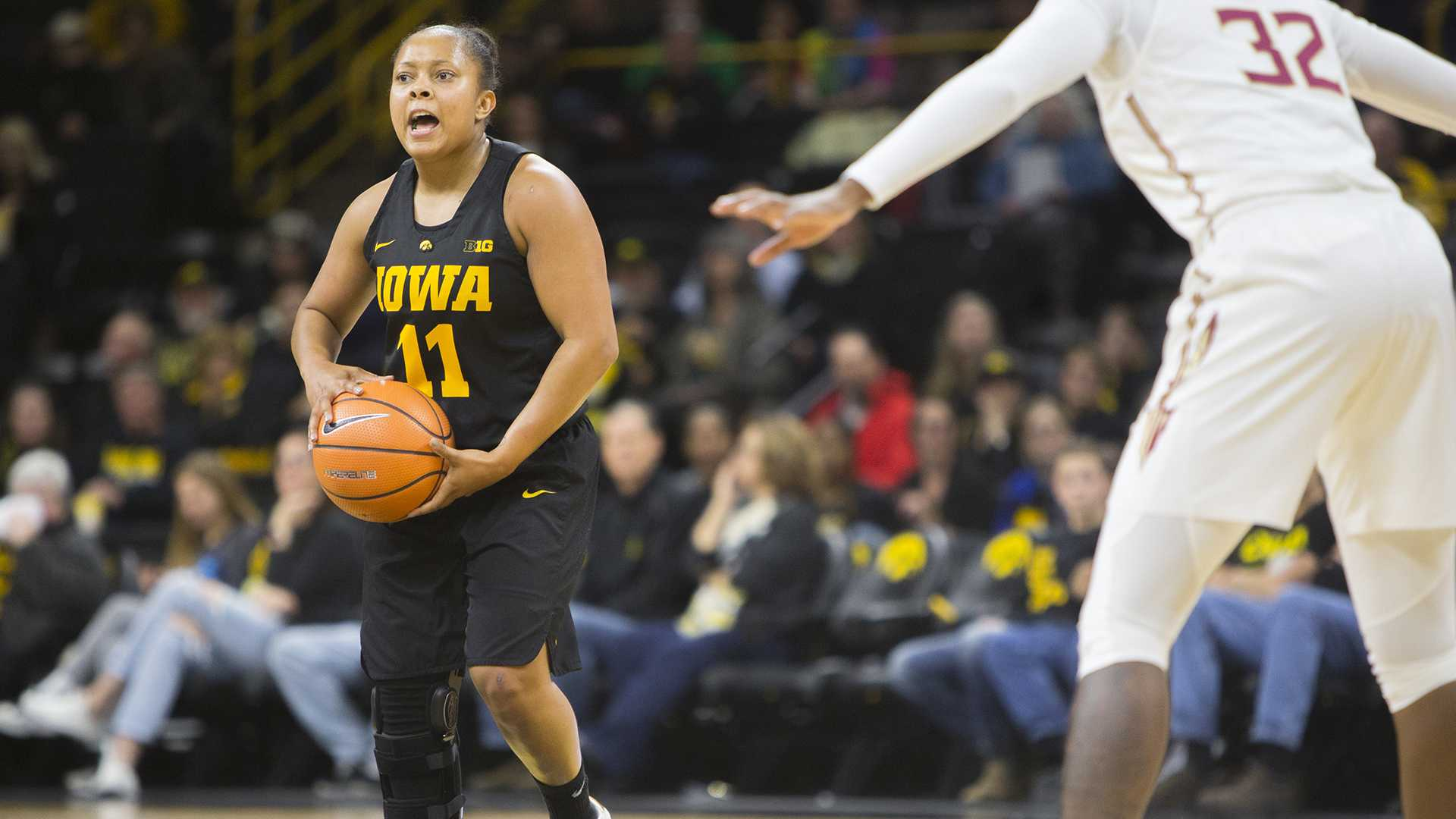 Iowa guard Tania Davis yells during the Iowa/Florida State Big Ten/ACC Challenge basketball game at Carver-Hawkeye Arena on Wednesday, Nov. 29, 2017. The Seminoles defeated the Hawkeyes, 94-93, in the Hawkeyes first loss of the season. (Lily Smith/The Daily Iowan)