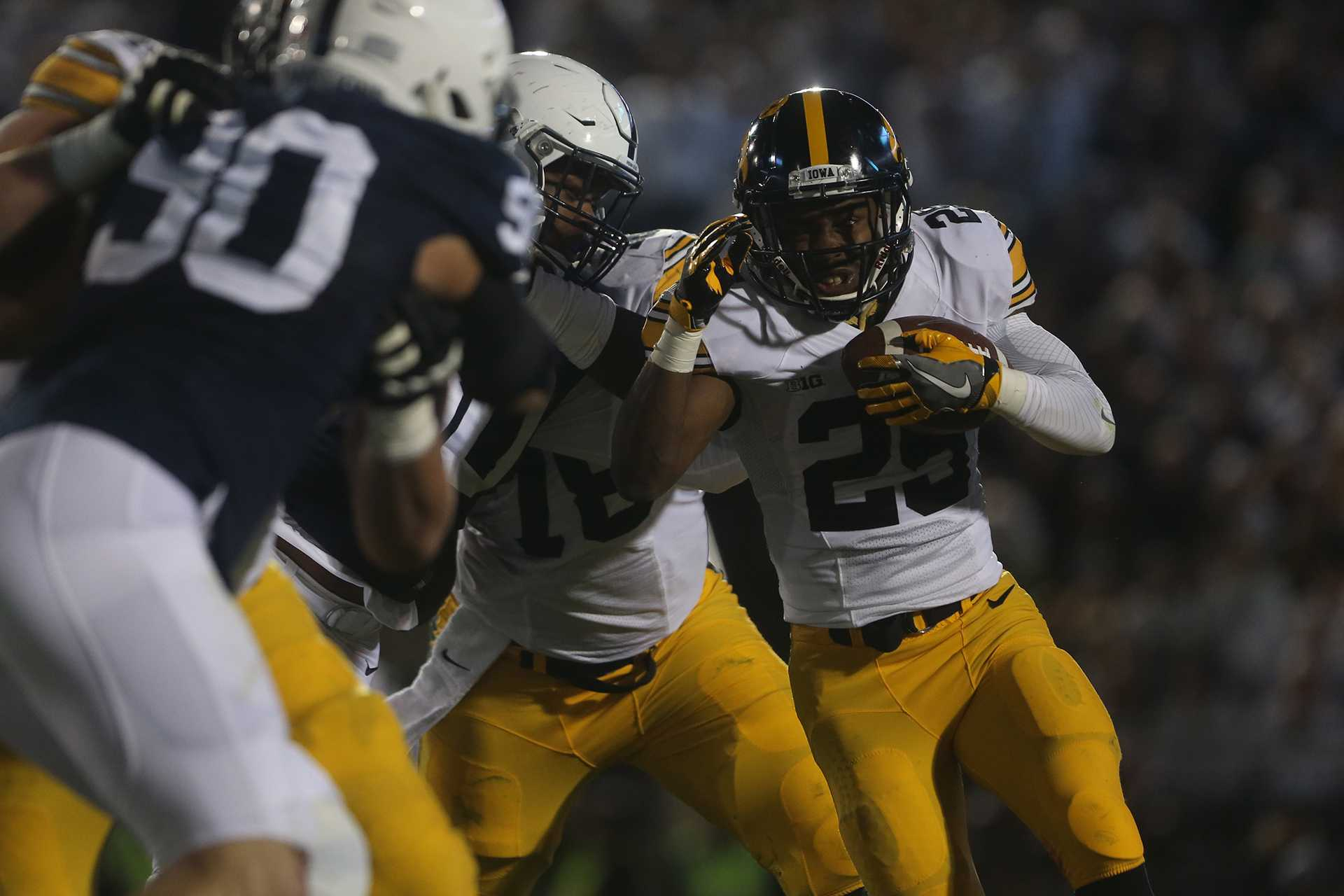 Iowa running back Akrum Wadley attempts to avoid Penn State defenders during the Iowa-Penn State game in Beaver Stadium in College State on Saturday, Nov. 5, 2016. The Nittany Lions defeated the Hawkeyes, 41-14. (The Daily Iowan/Margaret Kispert)