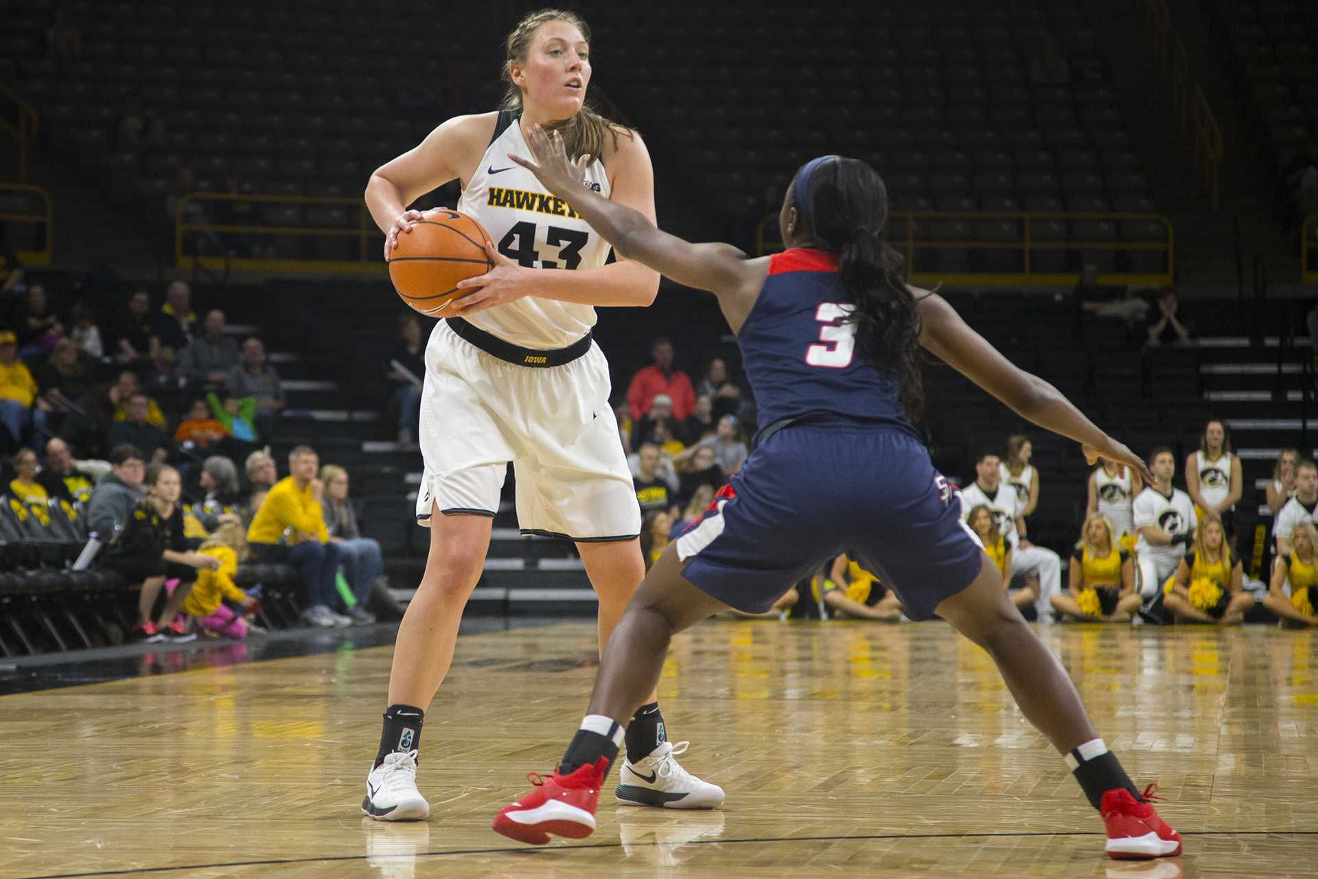 Iowa forward Amanda Ollinger guards the ball from Samford guard Shauntai Battle during the Iowa/Samford basketball game at Carver-Hawkeye Arena on Sunday, Dec. 3, 2017. The Hawkeyes defeated the Bulldogs, 80-59. (Lily Smith/The Daily Iowan)