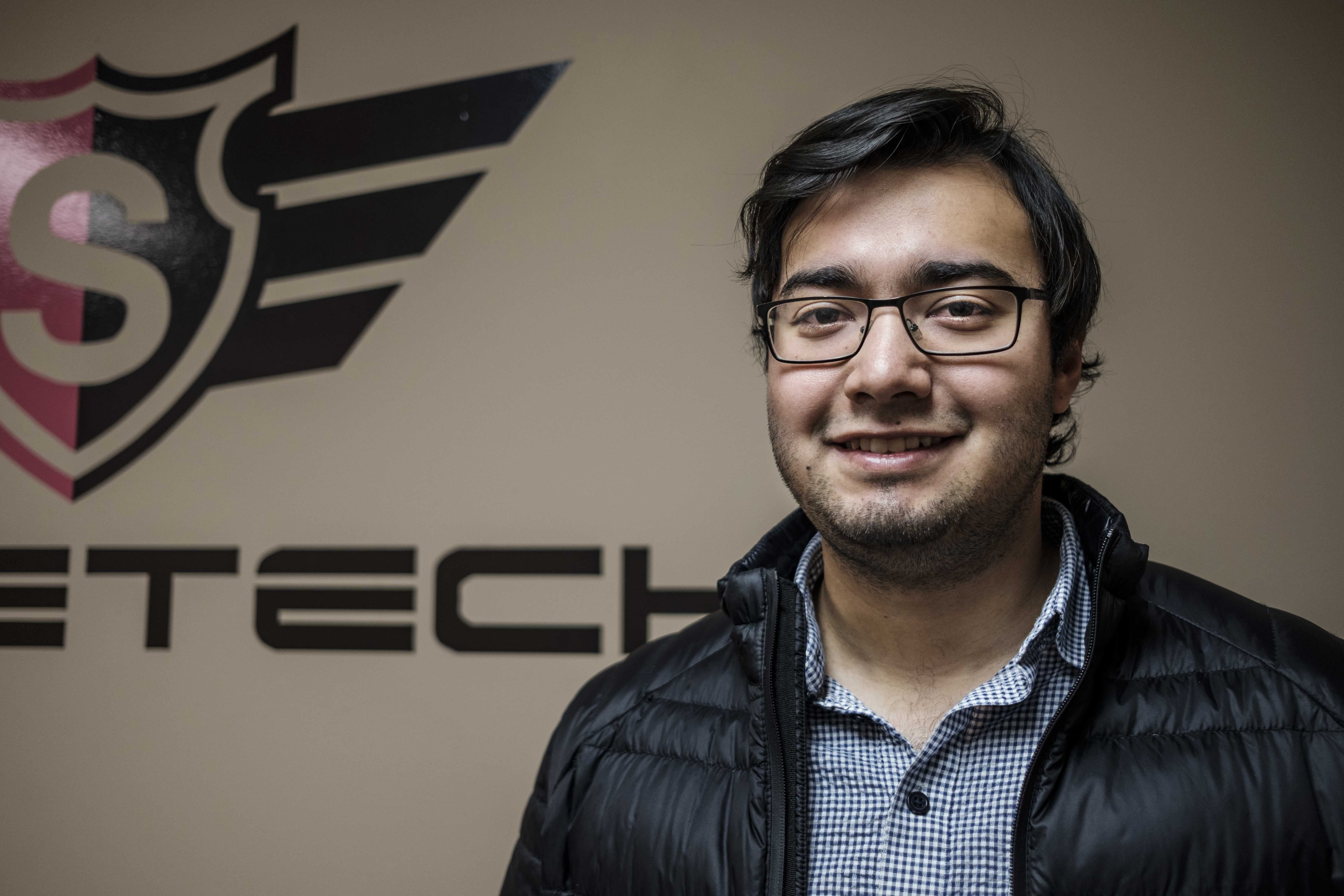Co-Founder of SwineTech Abraham Espinoza poses for a portrait at Swine Tech's Cedar Rapids office on Wednesday Dec. 6, 2017. Espinoza and University of Iowa classmate Matthew Rooda founded SwineTech while students at the university. (Nick Rohlman/The Daily Iowan)