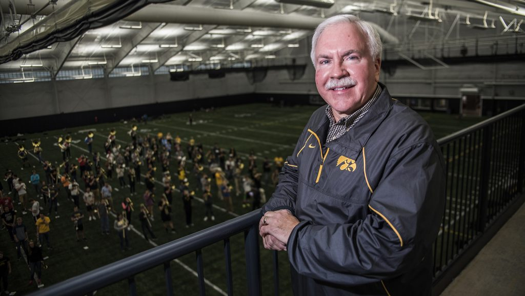 UI+Marching+Band+Director+Kevin+Kastens+poses+for+a+portraits+during+practice+at+the+Hawkeye+Tennis+and+Recreation+Center+on+Thursday%2C+Nov.+16.+Kastens+is+retiring+this+year+after+20+years+in+multiple+directorial+positions+at+the+University.+%28Ben+Smith%2FThe+Daily+Iowan%29
