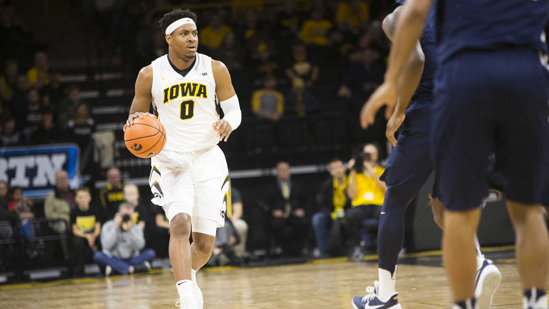 Iowa forward Ahmad Wagner dribbles up court during an Iowa/Penn State men's basketball game in Carver-Hawkeye Arena on Saturday, Dec. 2, 2017. The Nittany Lions defeated the Hawkeyes, 77-73. (Joseph Cress/The Daily Iowan)