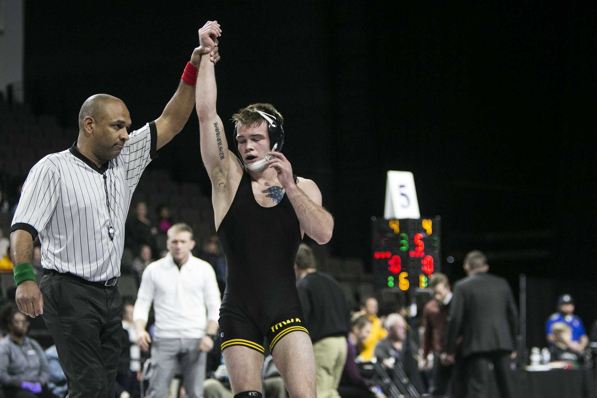 Iowa's 149-pound Brandon Sorensen has his arm raised after winning during the fourth session of the 55th Annual Midlands Championships in the Sears Centre in Hoffman Estates, Illinois, on Saturday, Dec. 30, 2017. (Joseph Cress/The Daily Iowan)