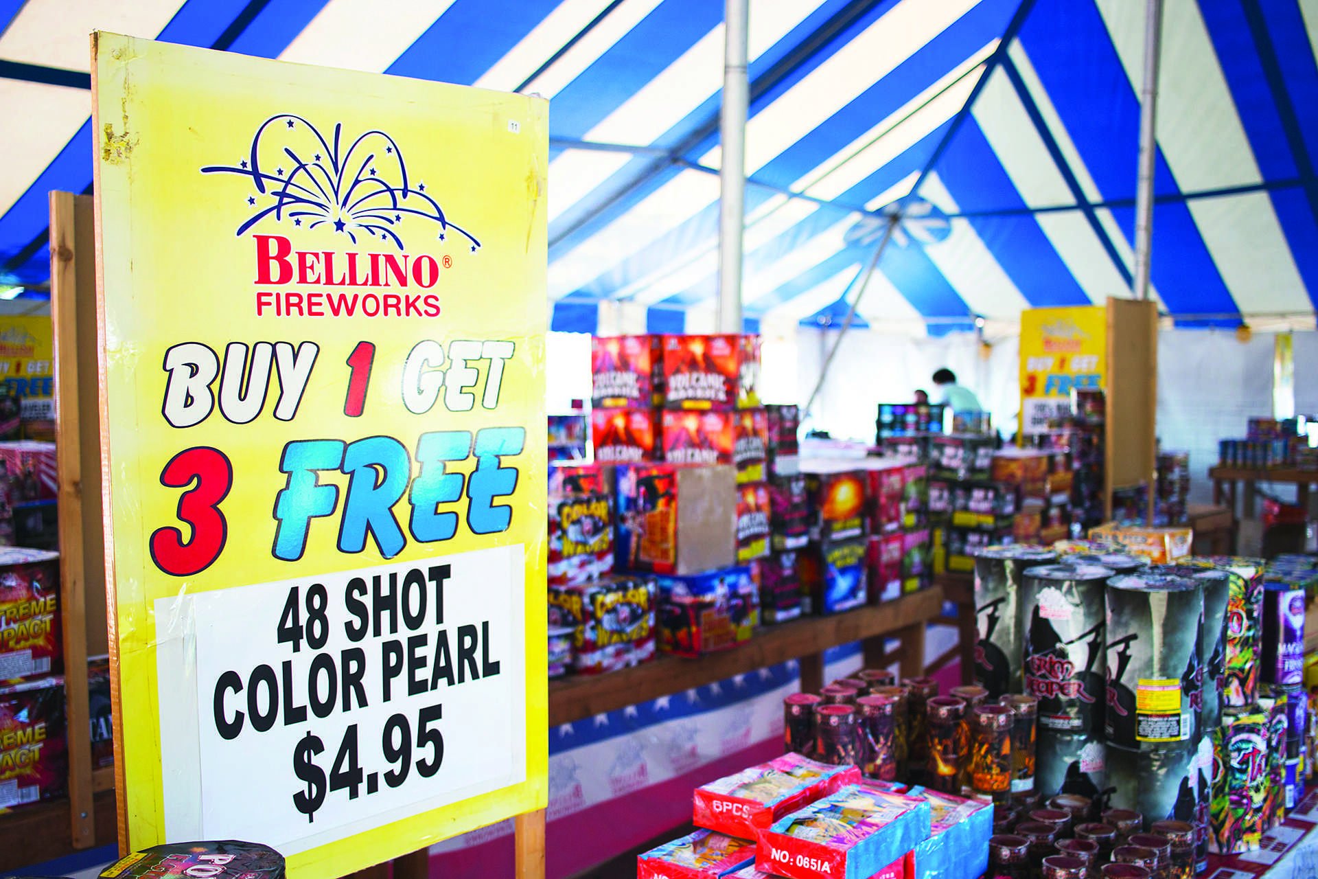 Fireworks are seen inside a Bellino Fireworks tent in the parking lot of the 1st Avenue Hy-Vee in Iowa City on Tuesday, June 27, 2017. State law says consumer fireworks may be sold and used in permitted areas and many be purchased by customers 18 or older. Iowa City Code says fireworks many not be used in city limits with an exception for novelty fireworks, such as sparklers and snakes. (Joseph Cress/The Daily Iowan)