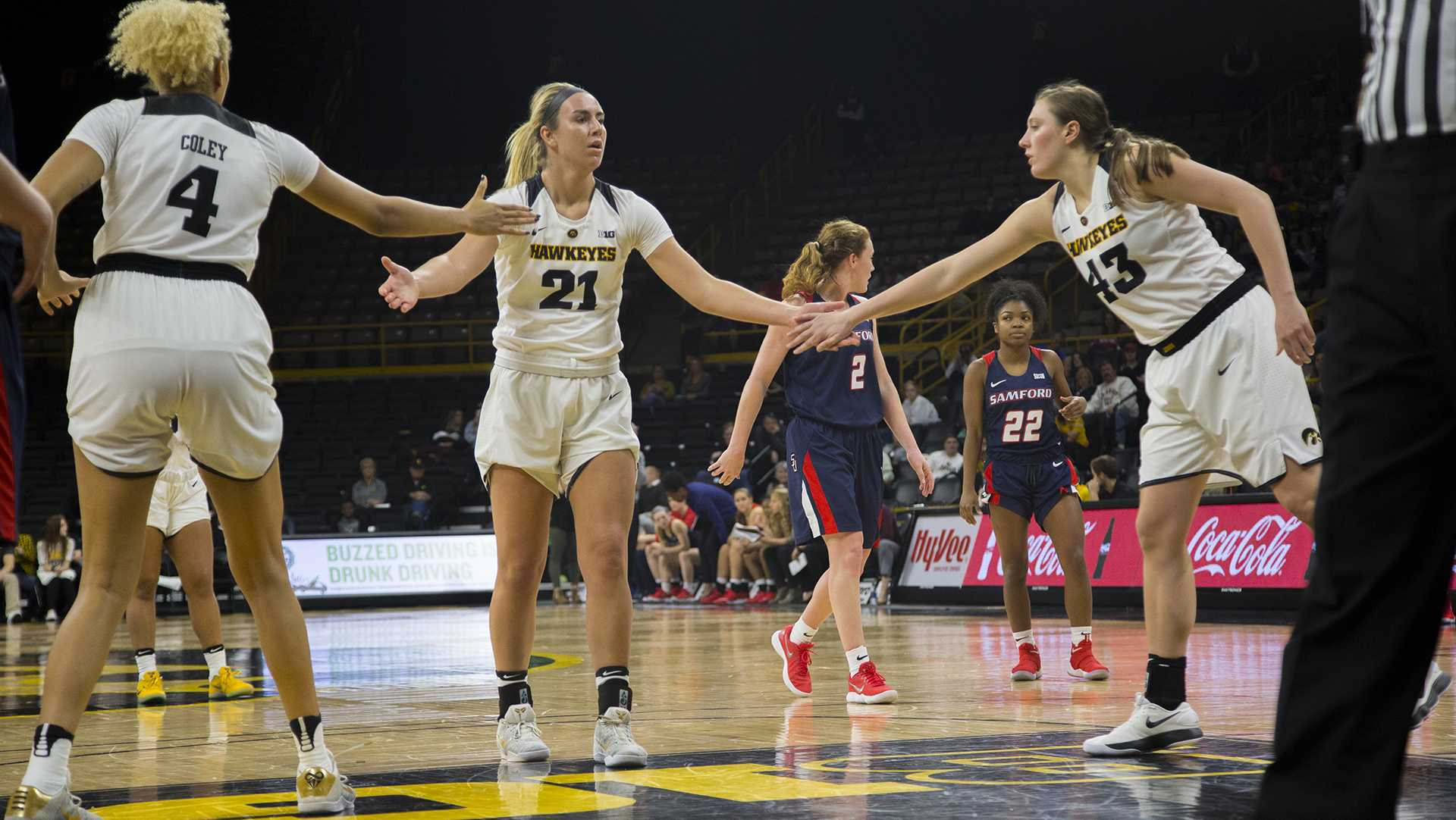 Iowa forward Hannah Stewart high fives forward Chase Coley and forward Amanda Ollinger during the Iowa/Samford basketball game at Carver-Hawkeye Arena on Sunday, Dec. 3, 2017. The Hawkeyes defeated the Bulldogs, 80-59. (Lily Smith/The Daily Iowan)