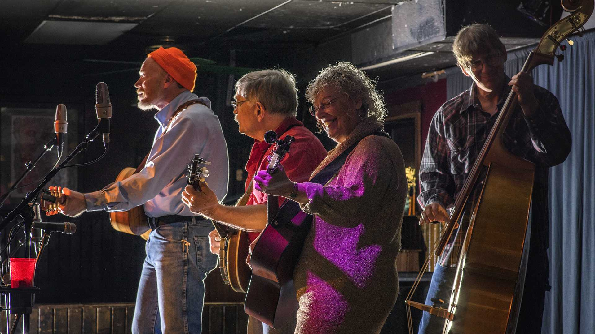 The bluegrass group, BandJoy, performs their setlist at The Mill on Wednesday, Dec. 6, 2017.      The bandmembers frequently switched between backup and lead singing throughout their performance. (James Year/The Daily Iowan)