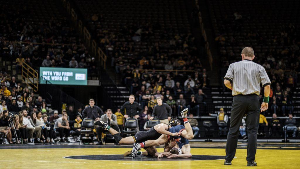 Iowa+wrestler+Michael+Kemerer+wrestles+against+Illinois%E2%80%99+Kyle+Langenderfer+during+a+meet+at+Carver+Hawkeye+Arena+on+Friday%2C+Dec.+1%2C+2017.+The+Hawkeyes+defeated+the+Illini+18-17.+%28Nick+Rohlman%2FThe+Daily+Iowan%29