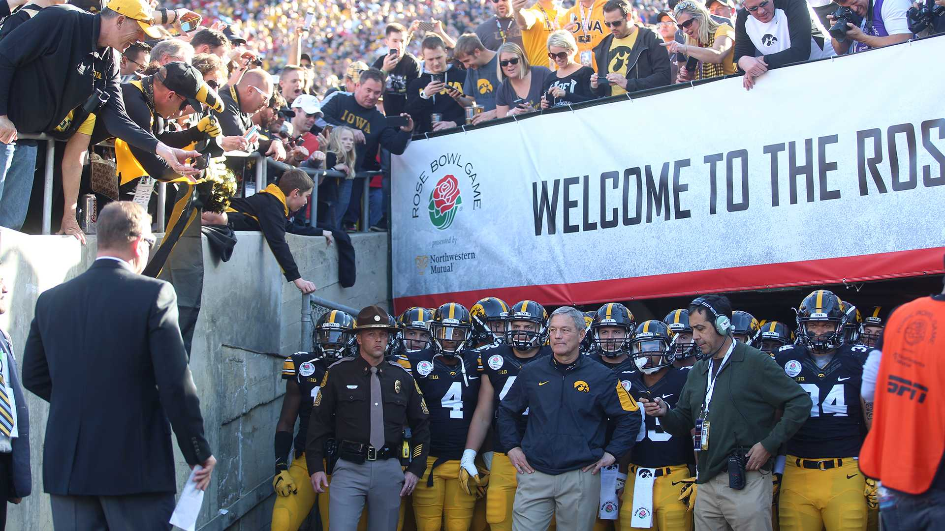 Iowa fans cheer for the team as they prepare to run out of the tunnel before the Rose Bowl Game in Rose Bowl Stadium in Pasadena, California on Friday, Jan. 1, 2016. Stanford defeated Iowa, 45-16. (The Daily Iowan/Alyssa Hitchcock)