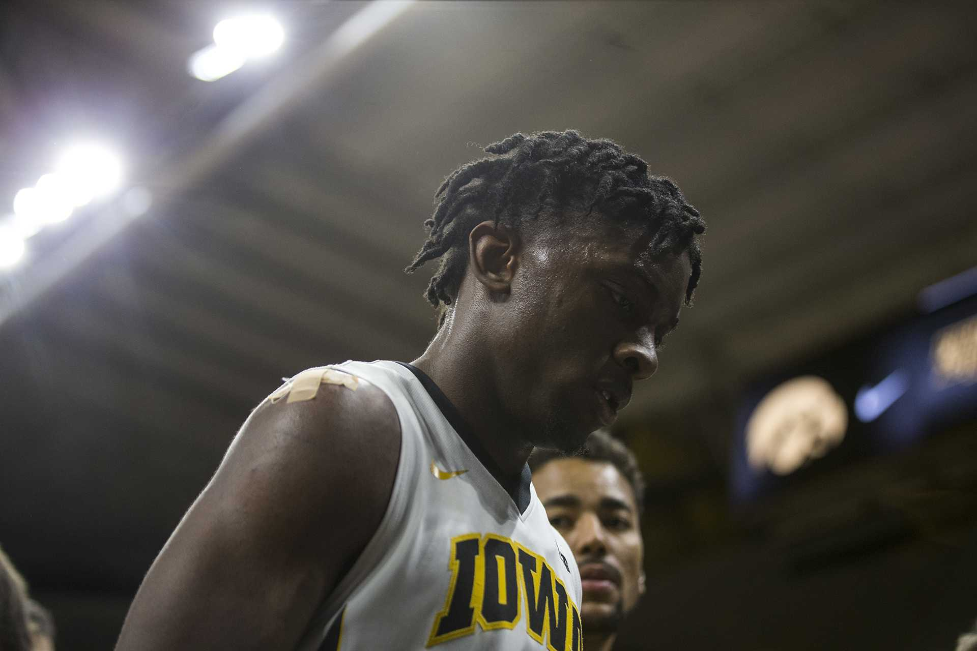 Iowa forward Tyler Cook walks off the court after the NCAA basketball game between Iowa and Michigan at Carver-Hawkeye Arena on Tuesday, Jan. 2, 2017. The Hawkeyes fell to the Wolverines 75-68. (Ben Allan Smith/The Daily Iowan)