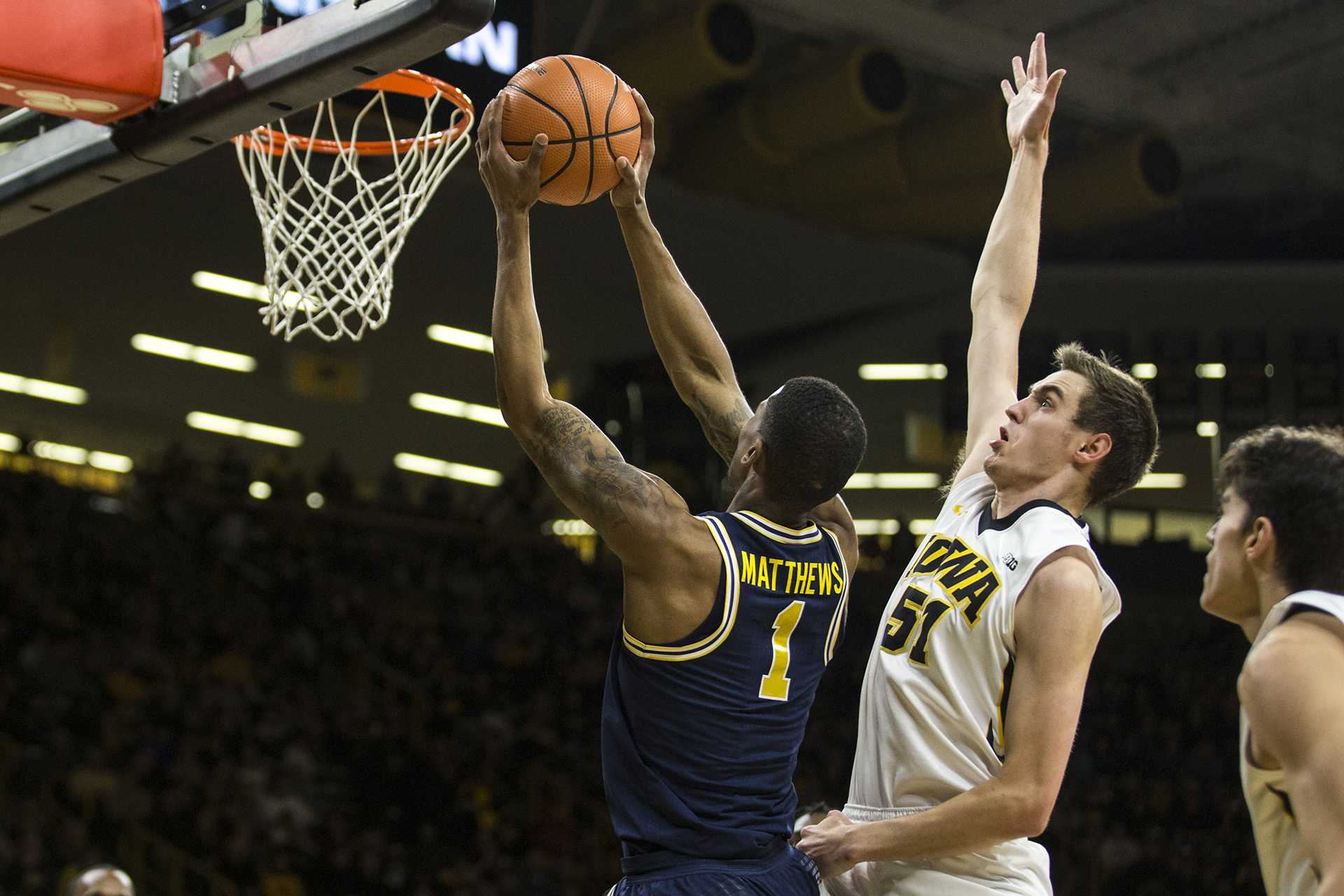Michigan guard Charles Matthews (1) dunks the ball in front of Iowa's Nicholas Baer (51) during the NCAA basketball game between Iowa and Michigan at Carver-Hawkeye Arena on Tuesday, Jan. 2, 2017. The Hawkeyes fell to the Wolverines 75-68. (Ben Allan Smith/The Daily Iowan)
