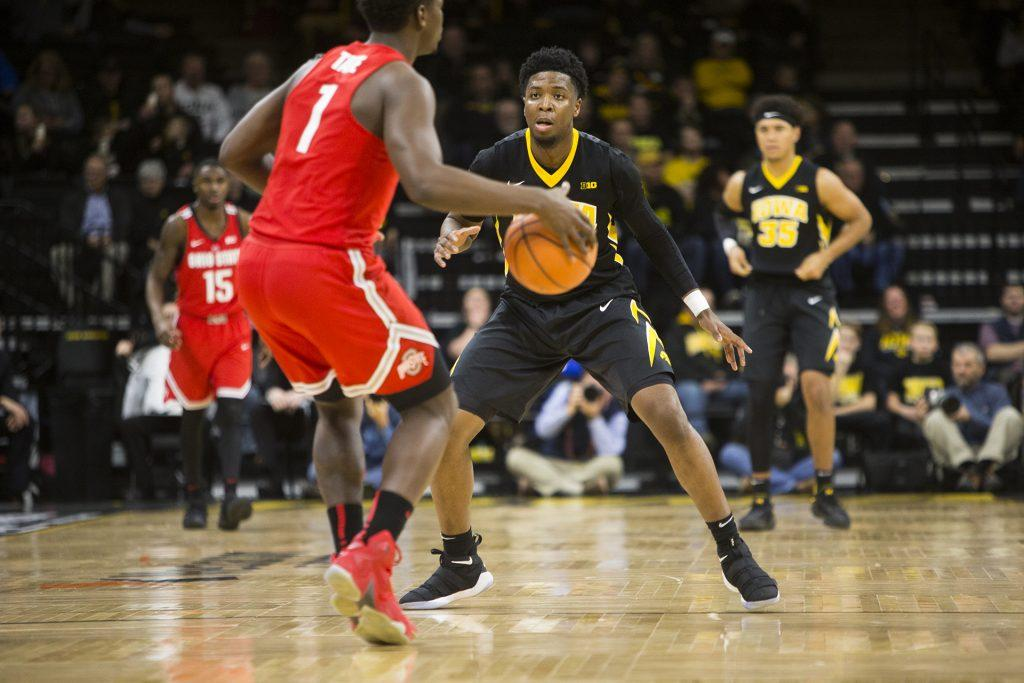 Iowa+guard+Isaiah+Moss+covers+Ohio+State+forward+Jae%27Sean+Tate+during+an+Iowa%2FOhio+State+men%27s+basketball+game+in+Carver-Hawkeye+Arena+on+Thursday%2C+Jan.+4%2C+2018.+The+Buckeyes+defeated+the+Hawkeyes%2C+92-81.+%28Joseph+Cress%2FThe+Daily+Iowan%29