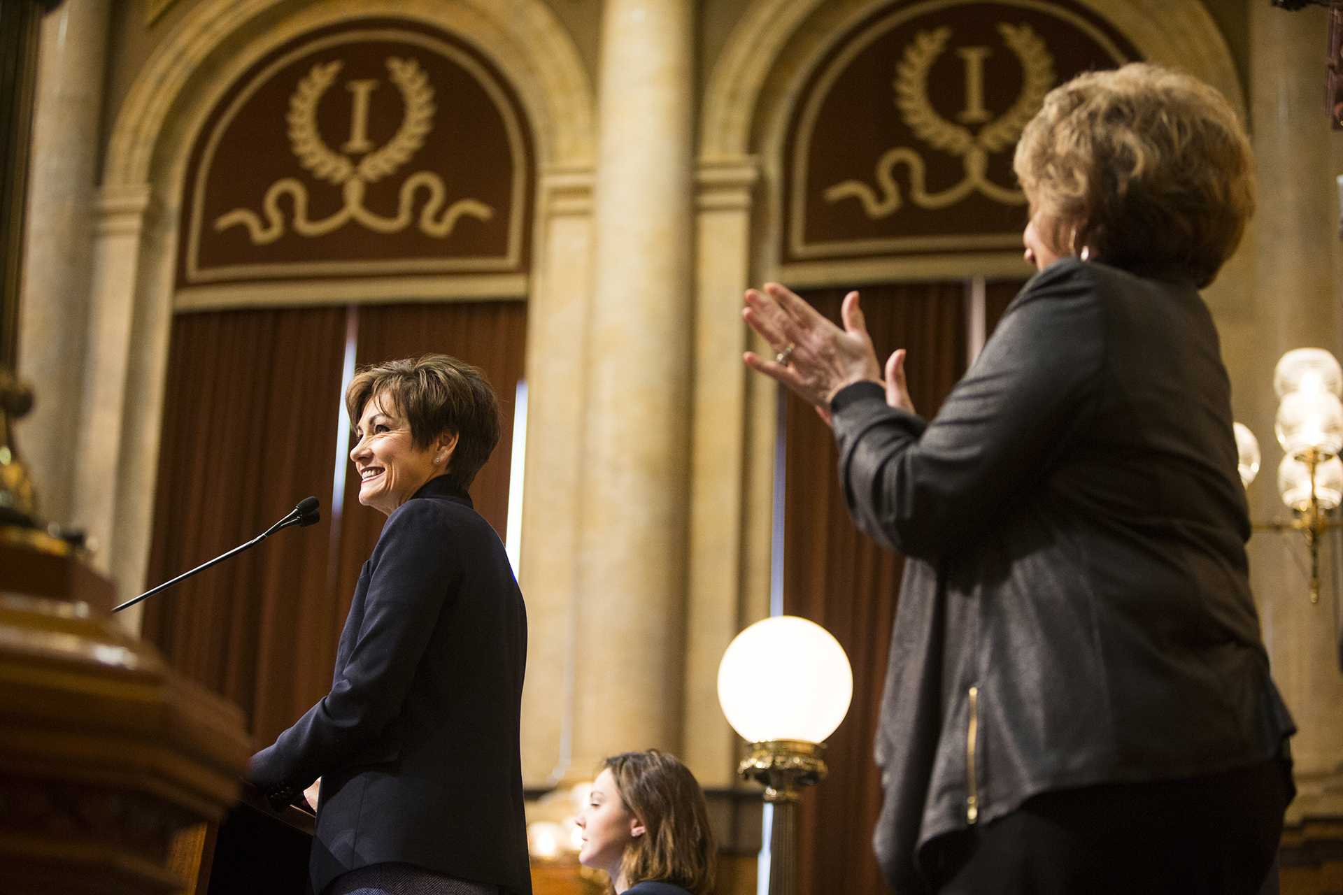 Iowa Gov. Kim Reynolds smiles while Iowa Speaker of the House Rep. Linda L. Upmeyer cheers during Gov. Reynolds first Condition of the State address in the Iowa State Capitol in Des Moines on Tuesday, Jan. 9, 2018. Reynolds took over the governor office in May of 2017. (Joseph Cress/The Daily Iowan)
