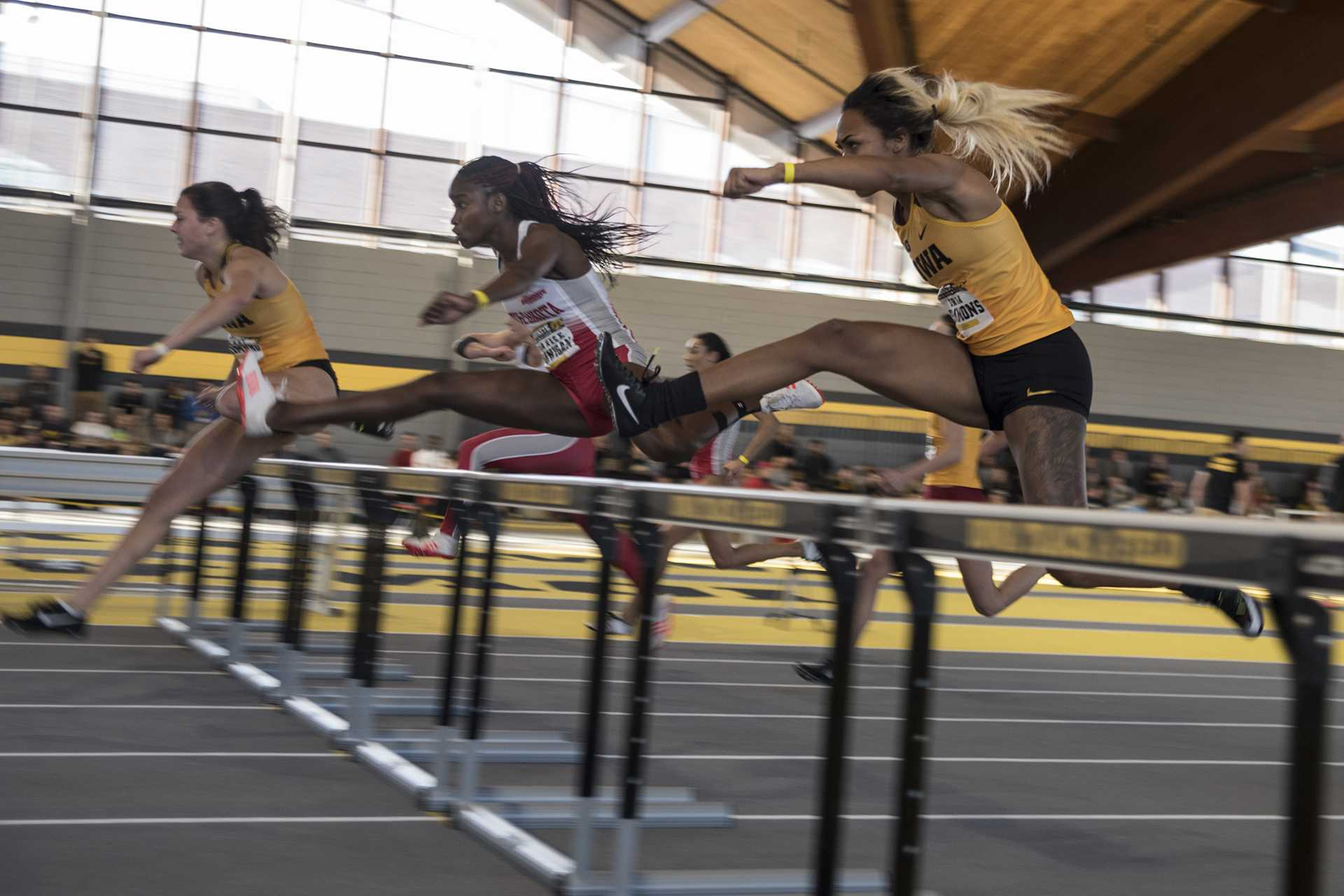 Iowa's Tria Simmons competes in the Women's 60 Meter Hurdles during the Hawkeye Invitational indoor track meet at the Campus Recreation Building on Satuday, Jan. 13, 2017. Simmons finished third with the time of 8.77. The Hawkeyes opened up the season with over 11 titles for the day. (Ben Allan Smith/The Daily Iowan)