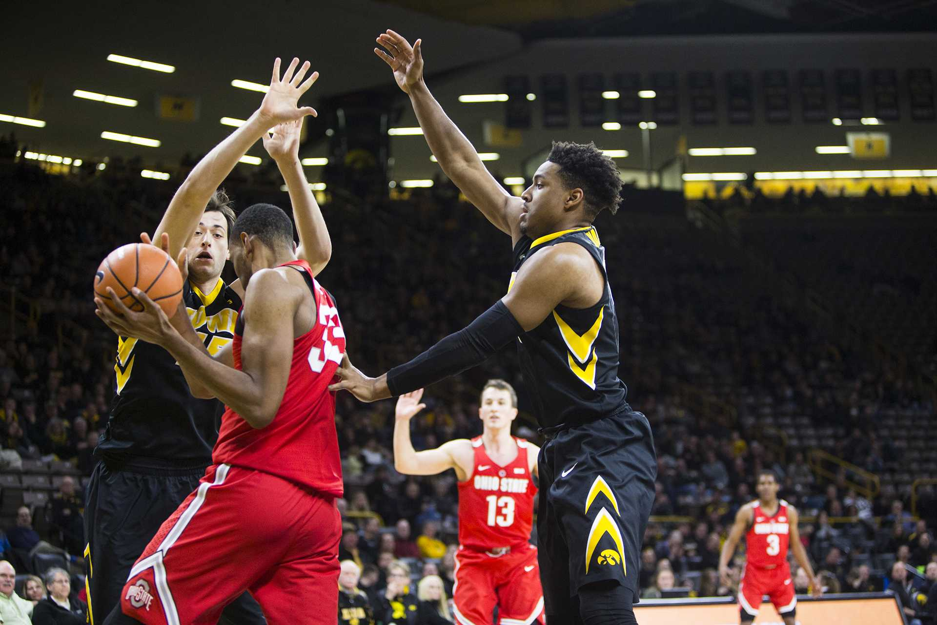 Iowa forward Ryan Kriener and Dom Uhl cover Ohio State forward Kieta Bates-Diop during an Iowa/Ohio State men's basketball game in Carver-Hawkeye Arena on Thursday, Jan. 4, 2018. The Buckeyes defeated the Hawkeyes, 92-81. (Joseph Cress/The Daily Iowan)