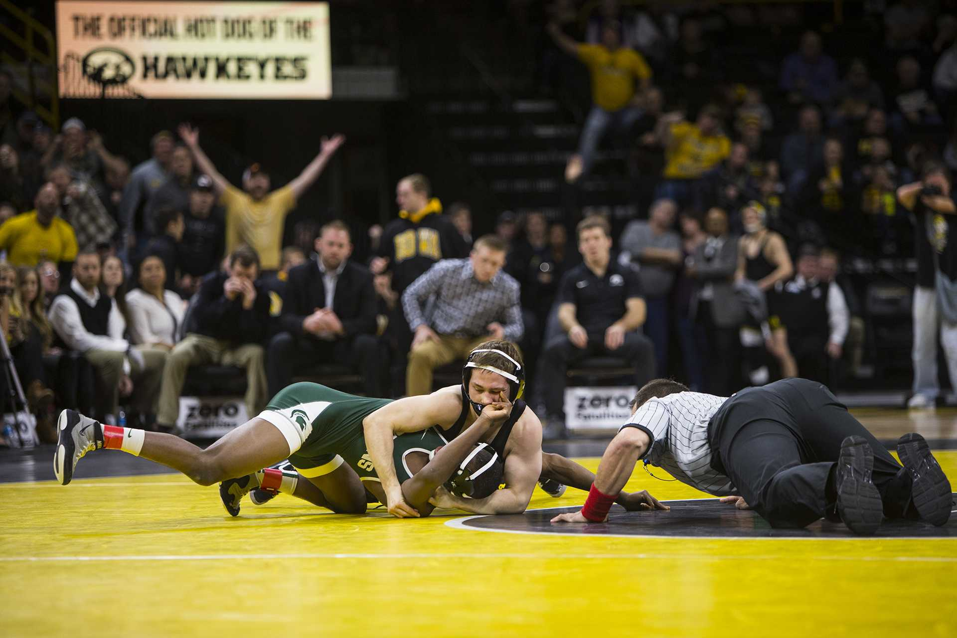 Iowa's 125-pound Spencer Lee pins Michigan State's Rayvon Foley during an Iowa/Michigan State wrestling matchup in Carver-Hawkeye Arena on Friday, Jan. 5, 2018. Lee pinned Foley in 0:46. (Joseph Cress/The Daily Iowan)