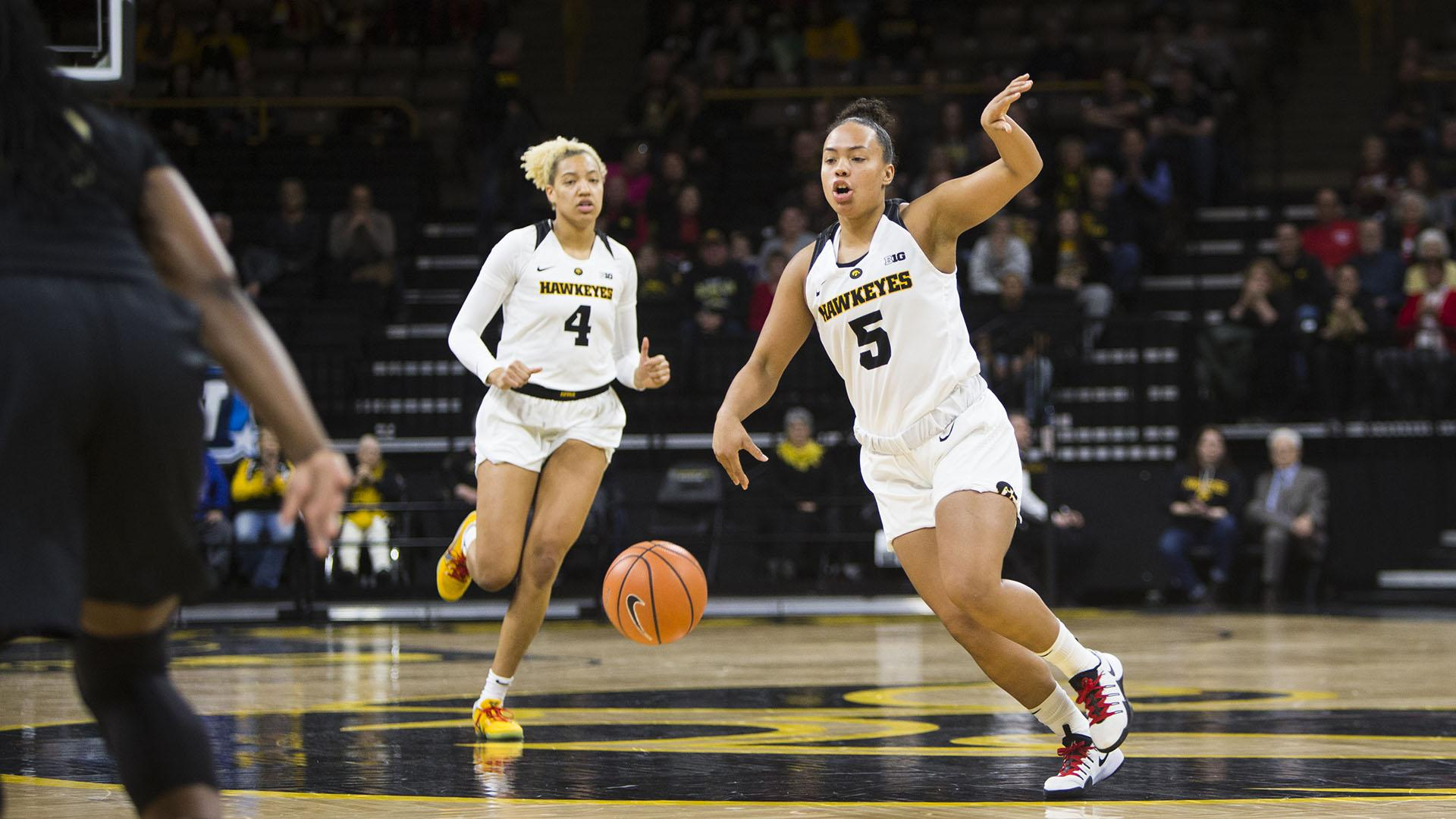 Iowa guard Alexis Sevillian gestures to teammate while taking the ball up the court during an Iowa/Purdue women's basketball game in Carver-Hawkeye Arena on Saturday, Jan. 13, 2018. The Boilermakers defeated the Hawkeyes, 76-70. (Joseph Cress/The Daily Iowan)