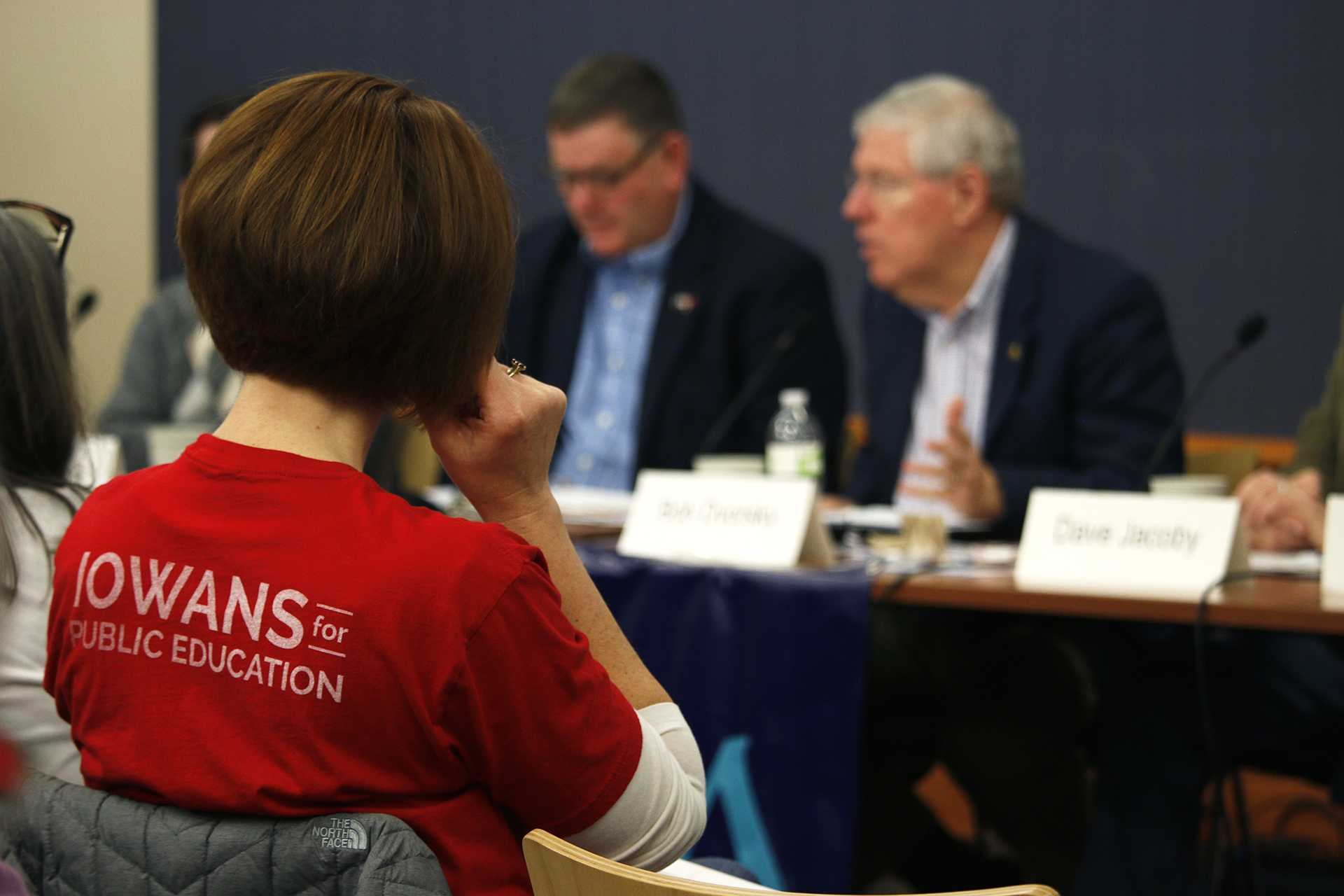 An attendee listens during the League of Women Voters Legislative Forum at the Iowa City Public Library on Saturday, Jan. 27, 2018. The event covered budget costs for transportation and education in different Iowa settings. (Katina Zentz/ The Daily Iowan)