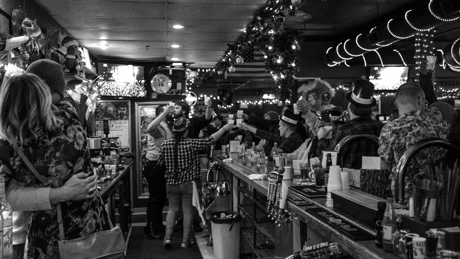 Today's feature photo -- Just after midnight on New Year's Day 2018 at the Deadwood Tavern in Iowa City. Bar patrons and employees partook in the traditional celebrations of a champagne toast and kissing a loved one. (Nick Rohlman/The Daily Iowan)