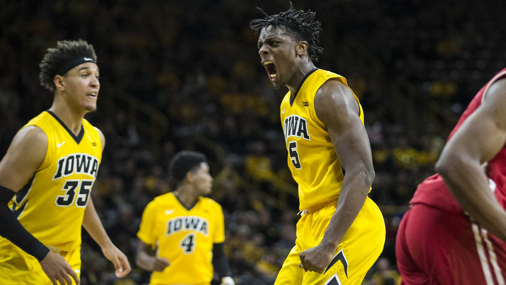 Iowa forward Tyler Cook (5) celebrates a dunk during the NCAA men's basketball game between Iowa and Wisconsin at Carver-Hawkeye Arena on Tuesday, Jan. 23, 2018. The Hawkeyes are going into the game with a conference record of 1-7. Iowa went on to defeat Wisconsin 85-67. (Ben Allan Smith/The Daily Iowan)