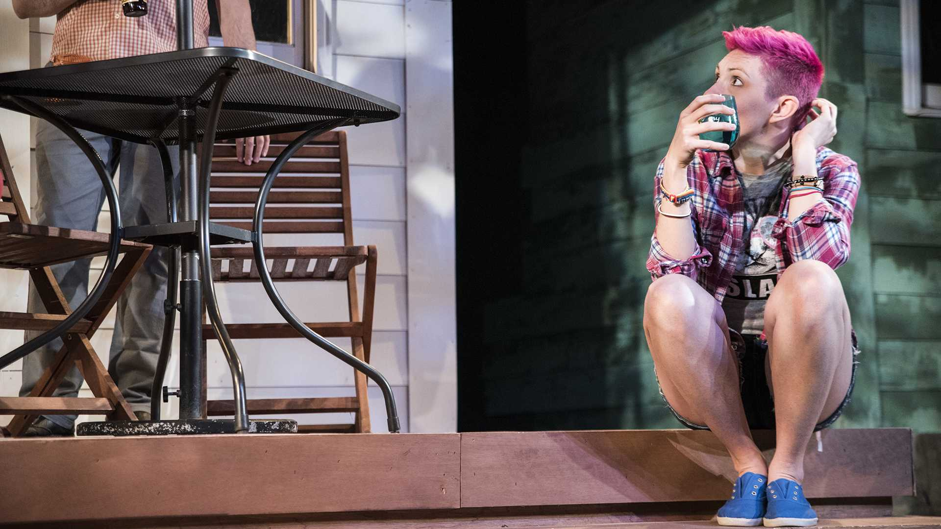 The character Mary holds a drink on stage during a dress rehearsal for the play Detroit at Riverside Theatre on Wednesday, Jan. 17, 2018. The play, written by Lisa D'Amour and directed by Angie Toomsen, was a finalist for the Pulitzer Prize and on the New York Times list for top ten plays of 2012. (Ben Allan Smith/The Daily Iowan)